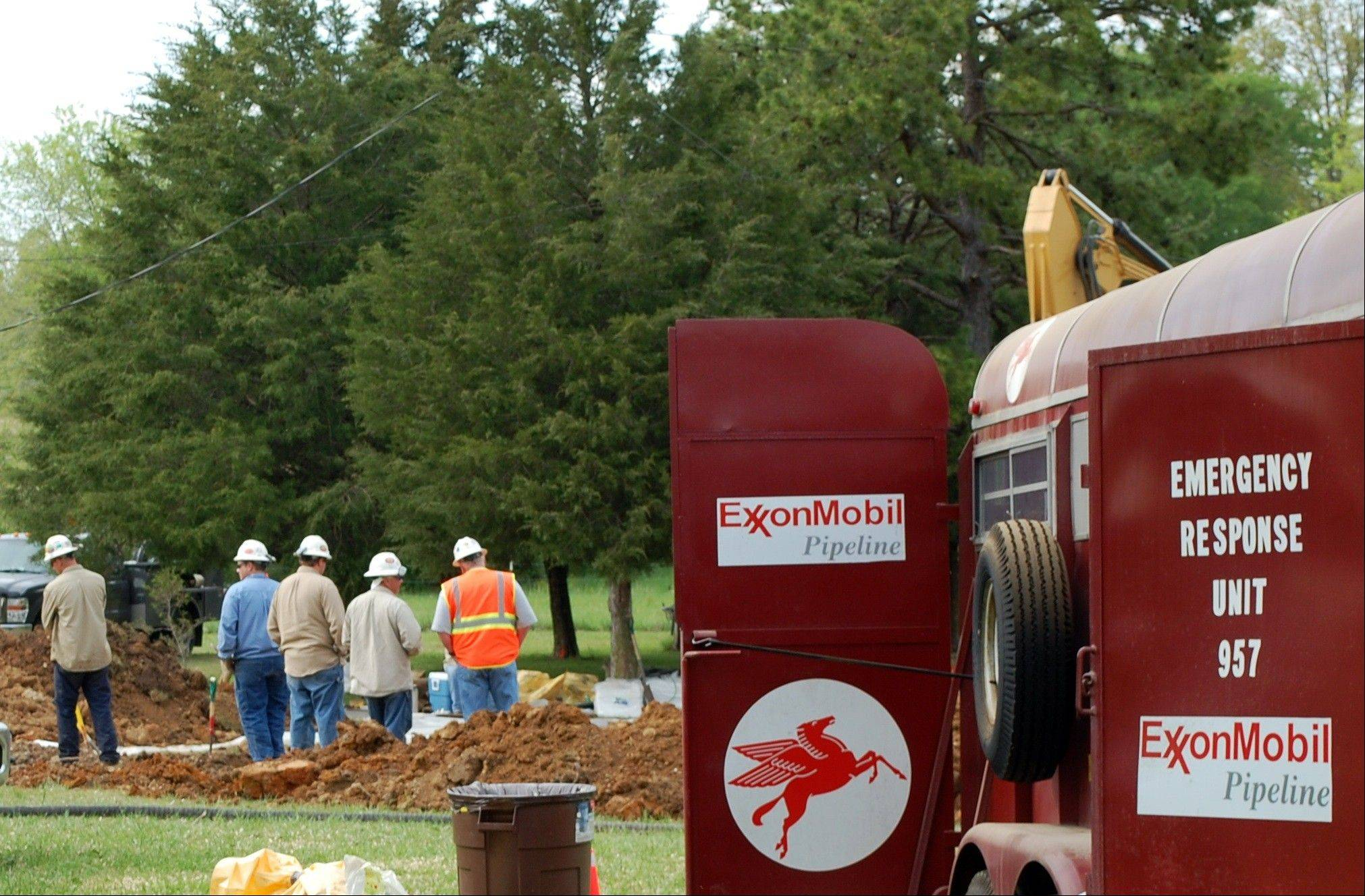 This Wednesday, May 1, 2013, photo provided by Ron Smith shows crew working at an oil leak site near Doniphan, Mo. ExxonMobil officials say cleanup is nearly complete after an oil leak from the Pegasus pipeline spilled about 42 gallons of crude - roughly one barrell - into the yard of a home.