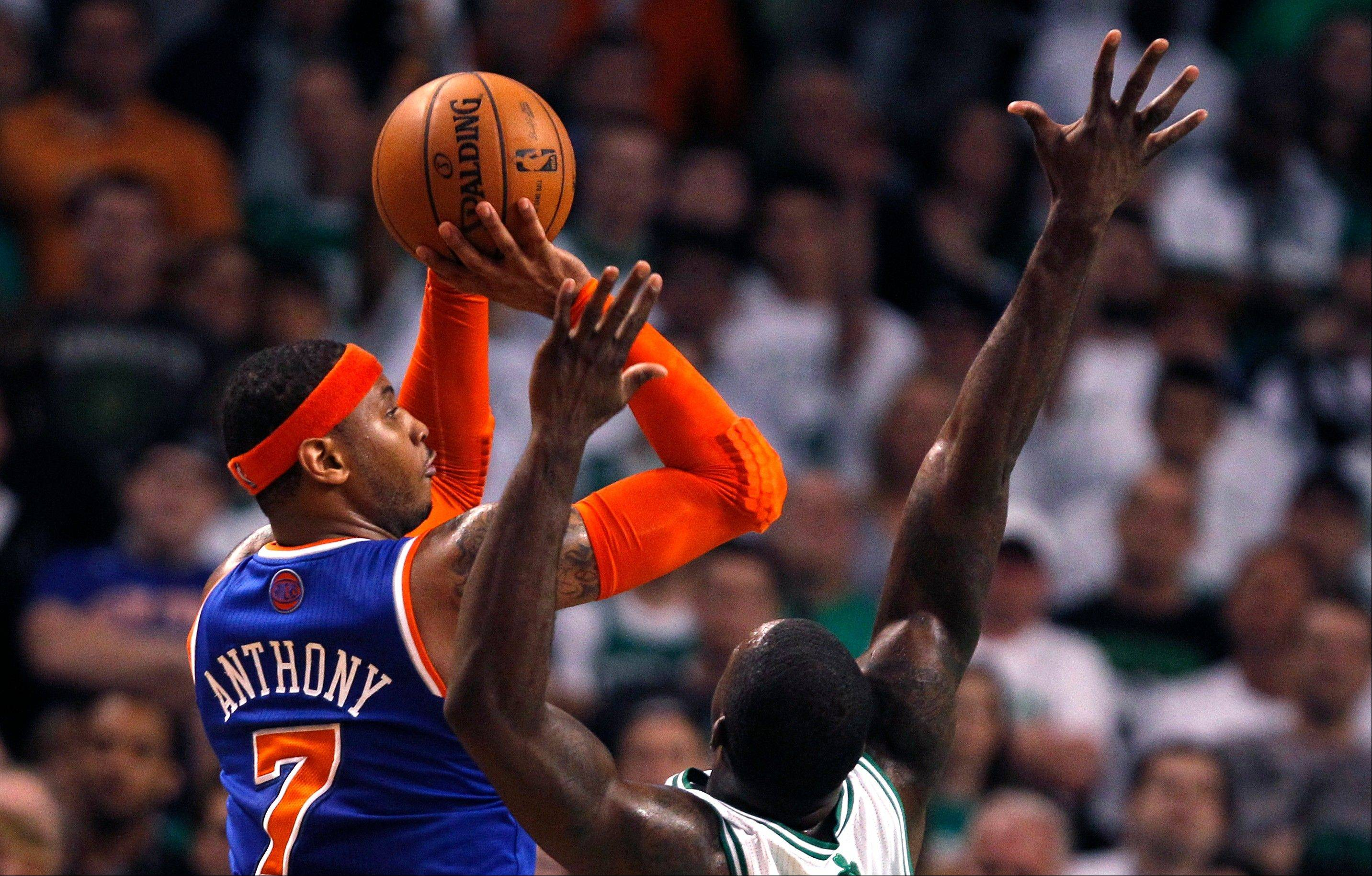 New York Knicks forward Carmelo Anthony (7) shoots over Boston Celtics forward Jeff Green during the second quarter in Game 6 of their first-round NBA basketball playoff series in Boston, Friday, May 3, 2013. (AP Photo/Charles Krupa)