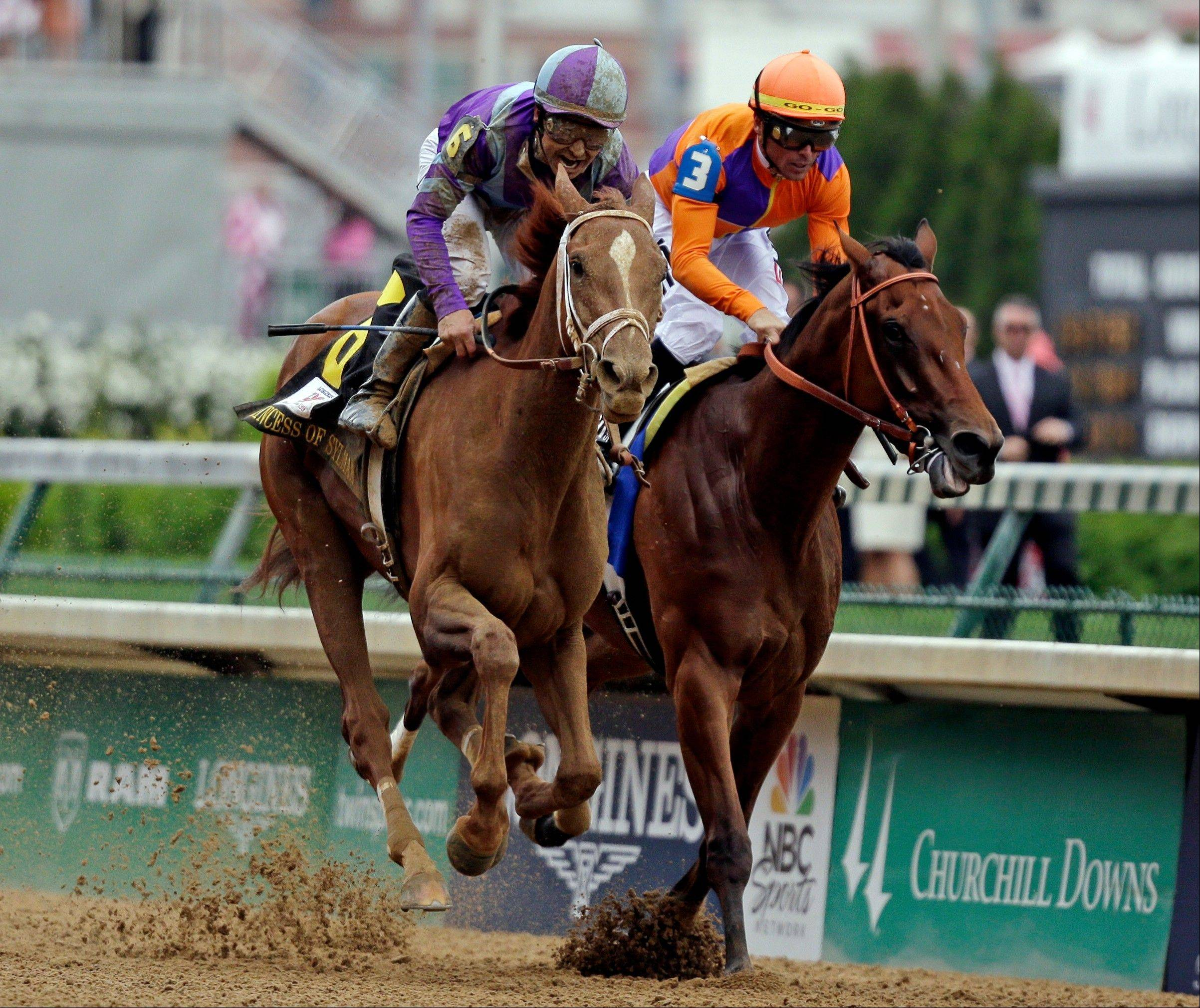 Mike Smith rides Princess of Sylmar to a win over Beholder ridden by Garrett Gomez in the 139th Kentucky Oaks at Churchill Downs Friday, May 3, 2013, in Louisville, Ky.(AP Photo/David Goldman)