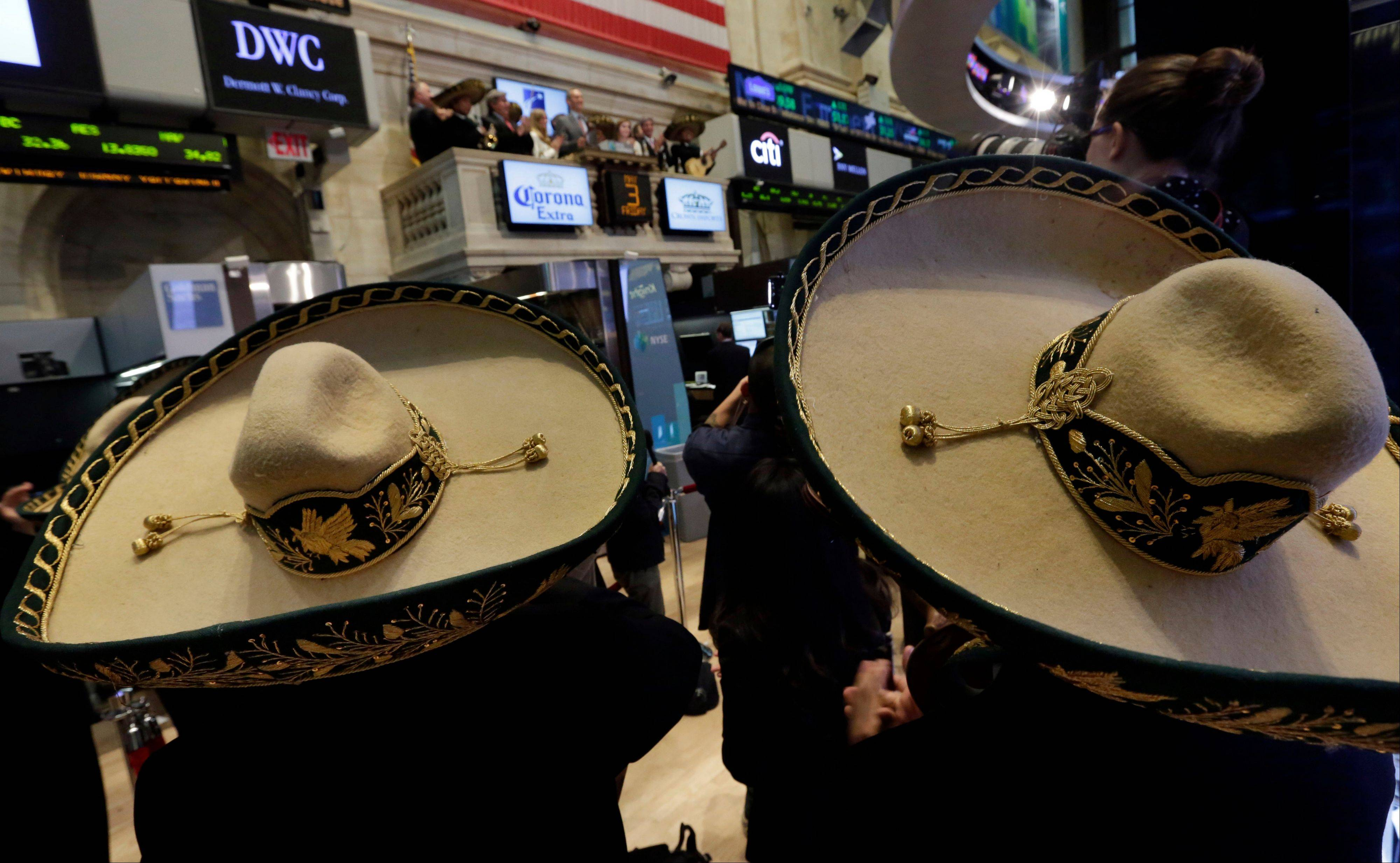 Mariachis wearing sombreros watch as Constellation Brands CFO Bob Ryder rings the New York Stock Exchange closing bell Friday, part of their Cinco de Mayo observance.
