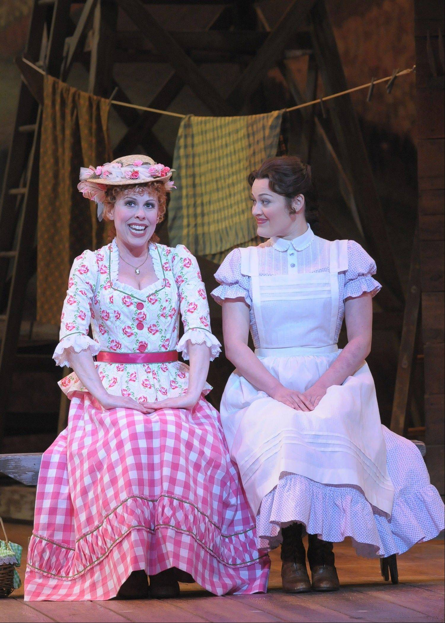 "Ado Annie (Tari Kelly) tells Laurie (Ashley Brown) why ""I Cain't Say No"" in the Lyric Opera of Chicago's new production of Rodgers and Hammerstein's 1943 Broadway musical ""Oklahoma!,"" now playing though Sunday, May 19."