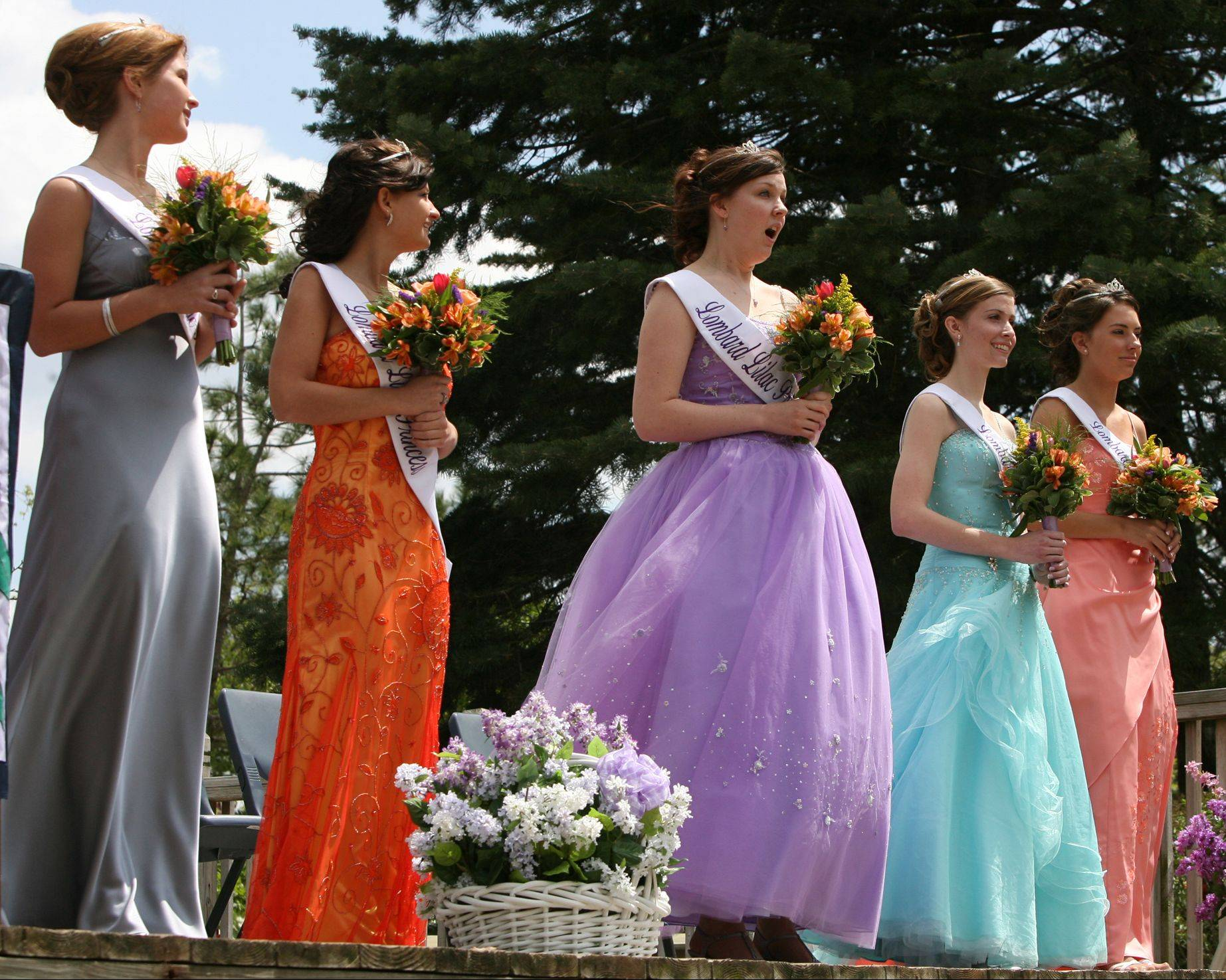 Lilac Princesses, including 2009 queen Jamie Lemens, are recognized during a ceremony at Lilacia Park. This year's Lilac Queen coronation will continue a tradition of more than 80 years as it takes place at 1 p.m. Saturday, May 4, in the park.