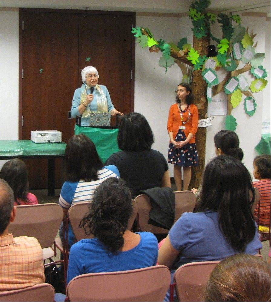 Nancy J. Heggem described the judging process and announced the winners with librarian Tracie Amirante Padal.