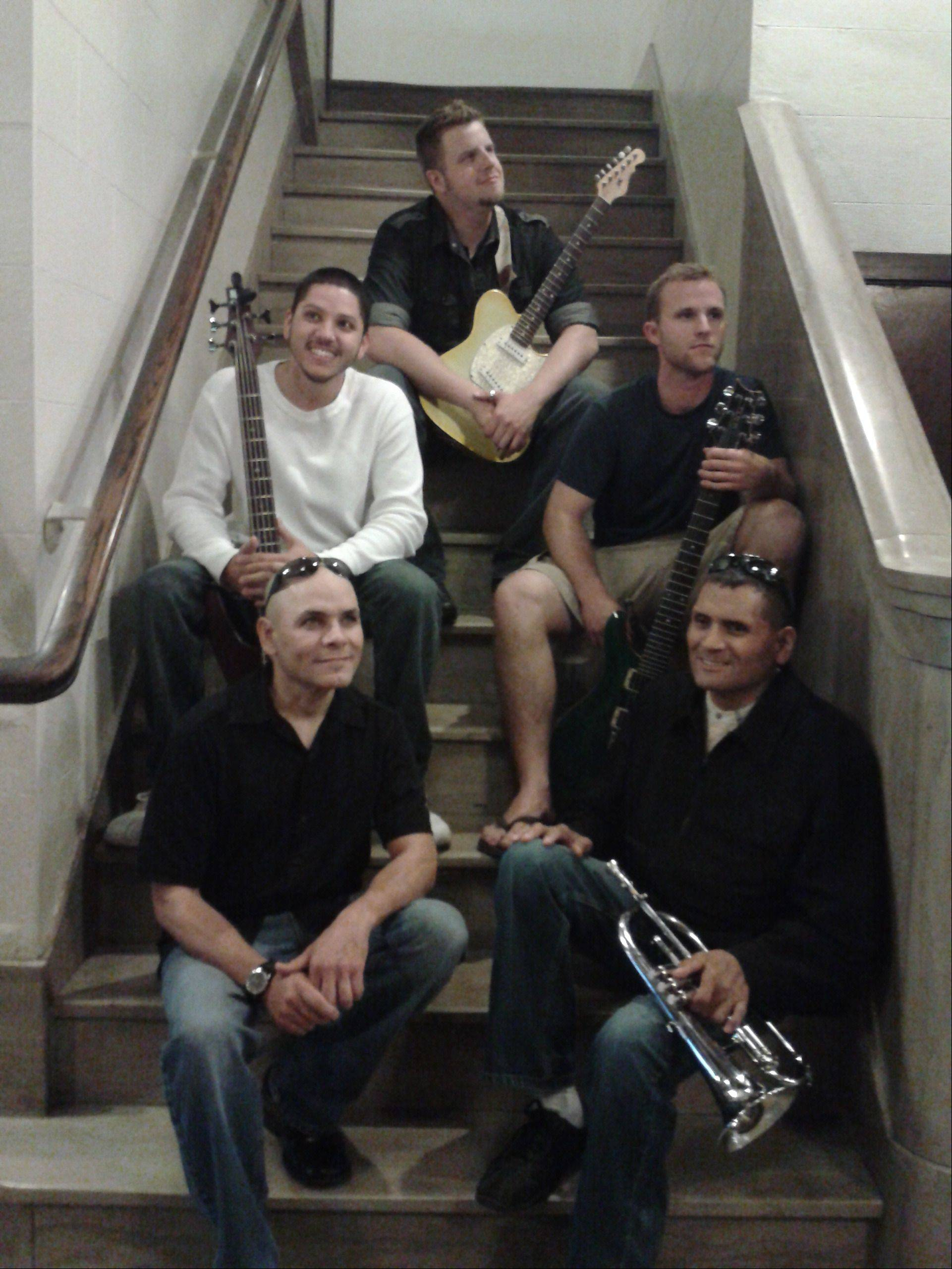 The Elgin-based band P.U.S.H. will make its live radio debut Sunday. Picture here are, bottom row, lead vocalist Oswald Mendez and keyboard and trumpet player Fred Gomez; middle row, guitarist Andrew Olson and bass player Luis Baez; and top row, guitarist Roger Alvarez. Not pictured are drummers William Rawlings and Giovanni Valdez.