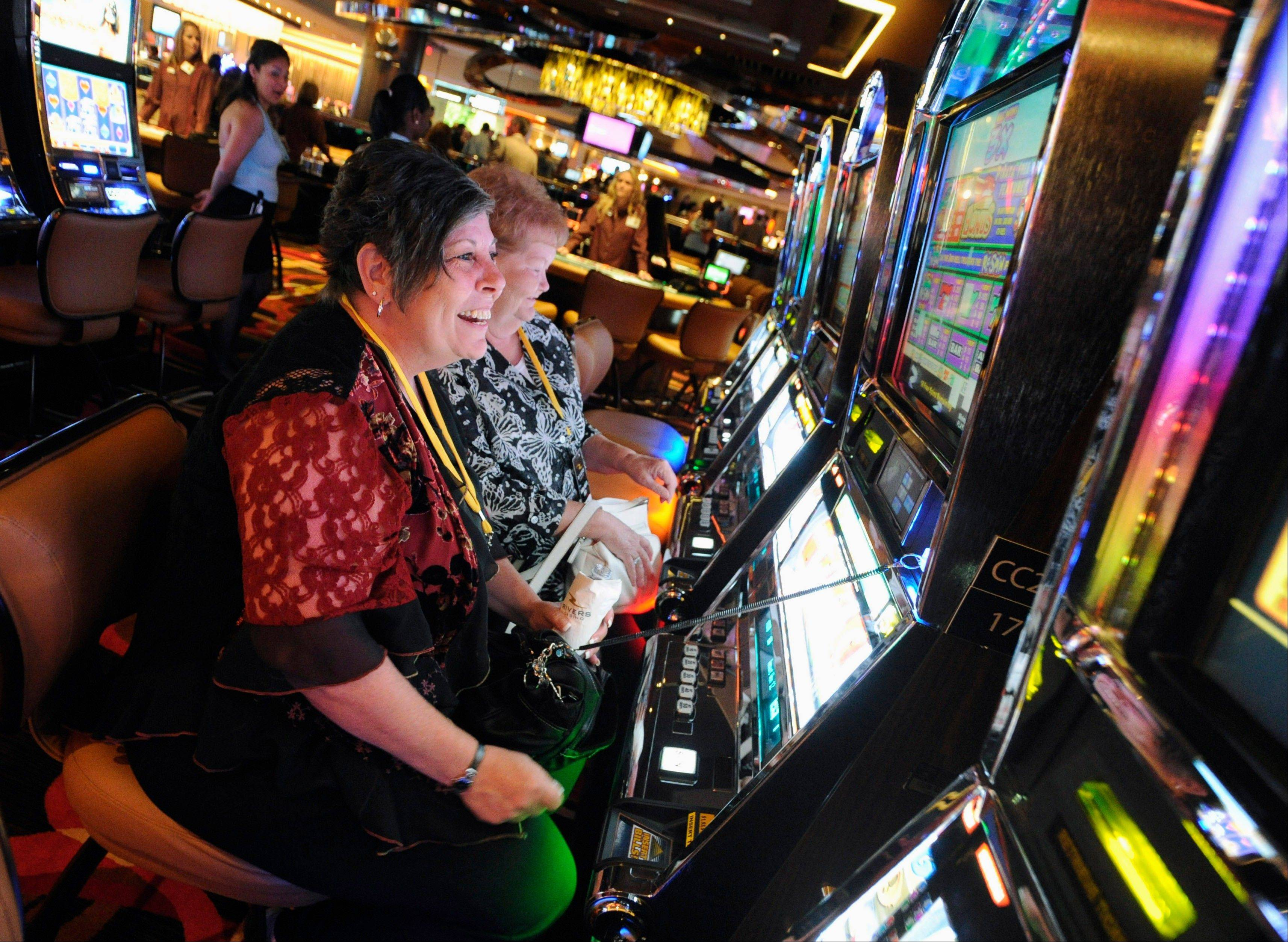 Karen Lingermuth of Niles plays the slots during a special VIP event at the new Rivers Casino in Des Plaines in 2011. A refined plan to add more casinos and slot machines in Illinois was approved by the Illinois Senate Wednesday.