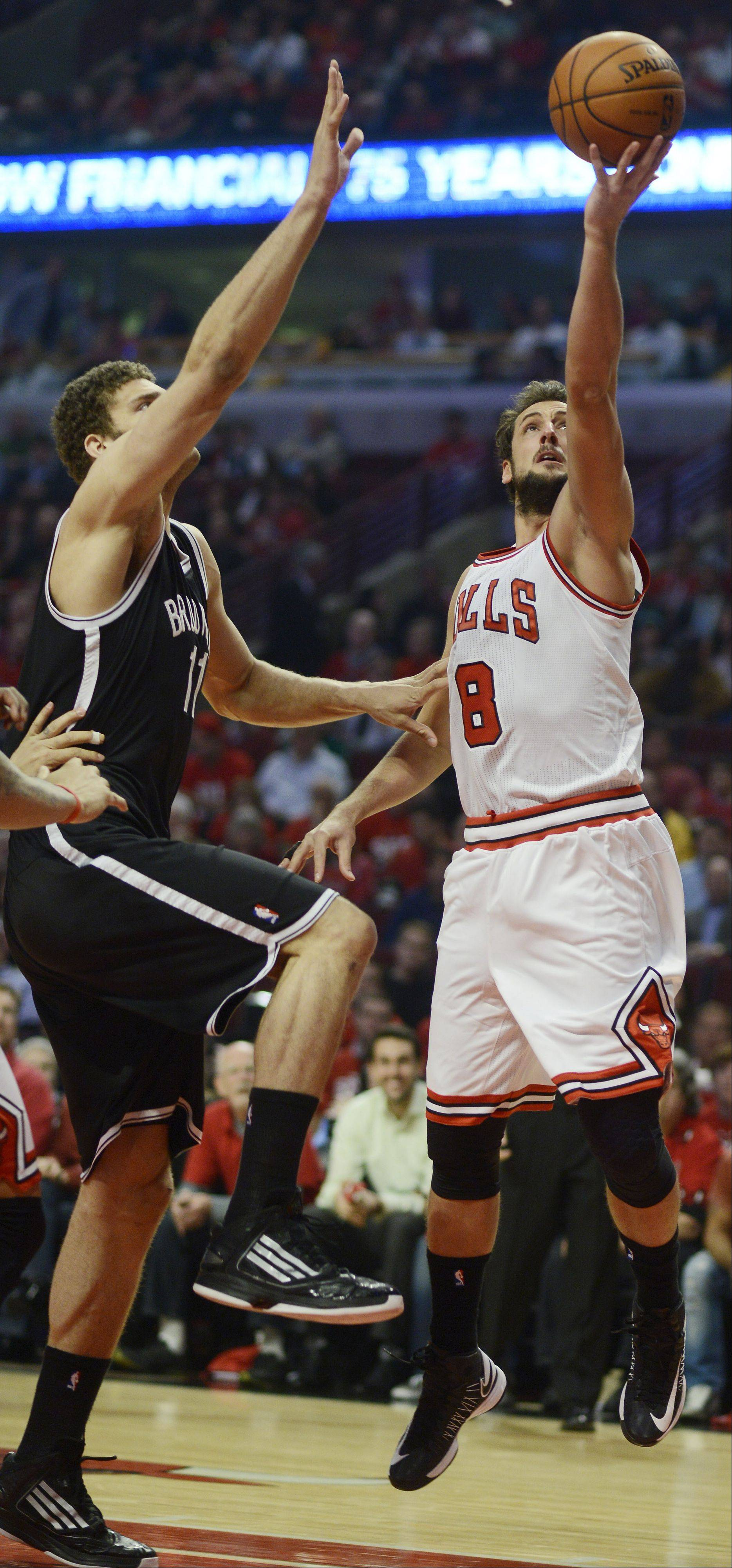 JOE LEWNARD/jlewnard@dailyherald.comMarco Belinelli of the Chicago Bulls drives to the basket for a layup against Brooklyn Nets defender Brook Lopez during the first quarter in Game 6 of the first round playoff game at the United Center in Chicago, Thursday, May 2, 2013.