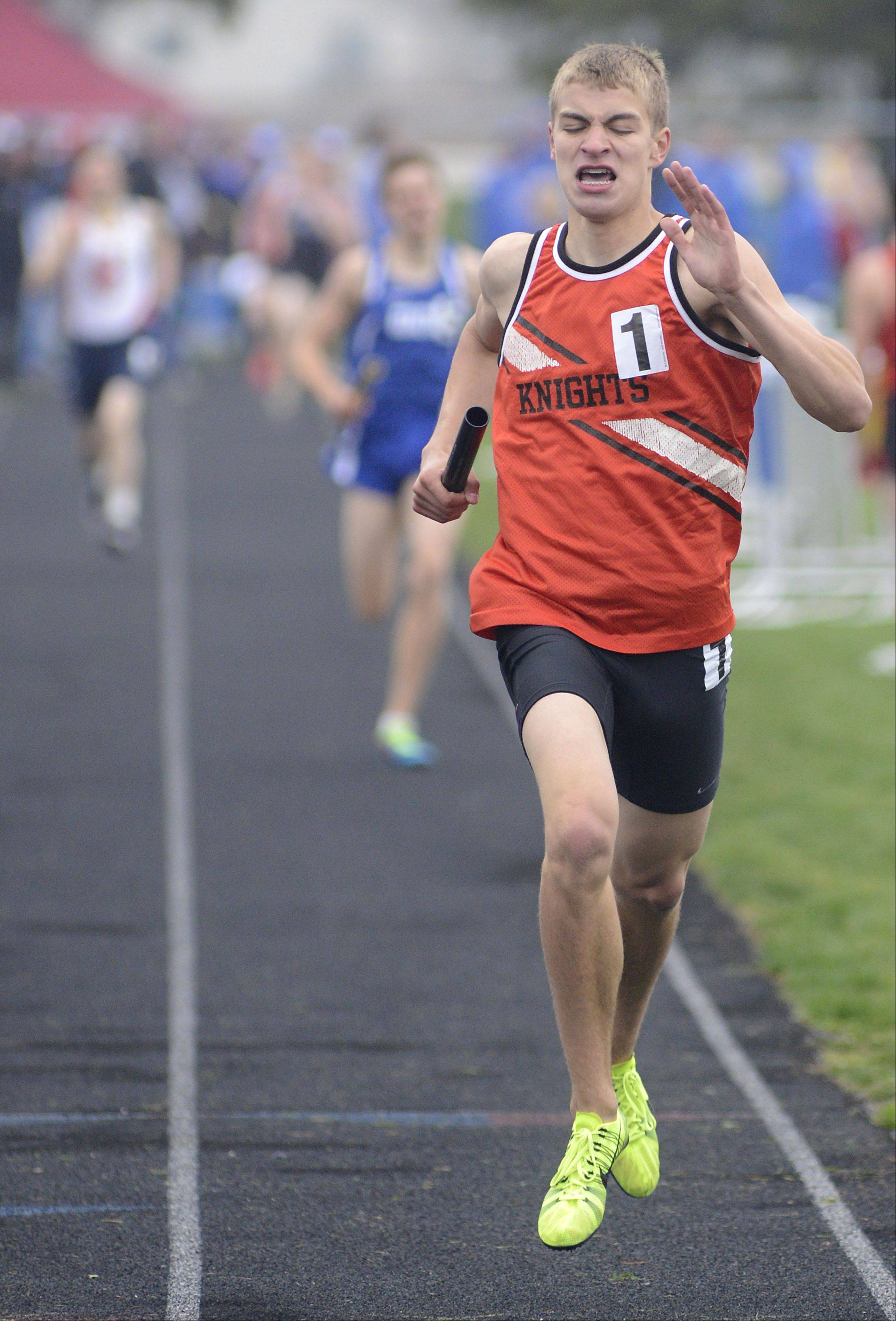 Kaneland's Nathaniel Kucera brings the Knights in with first place in the 4 x 800 meter relay at the Kane County boys track meet at Burlington Central on Friday.