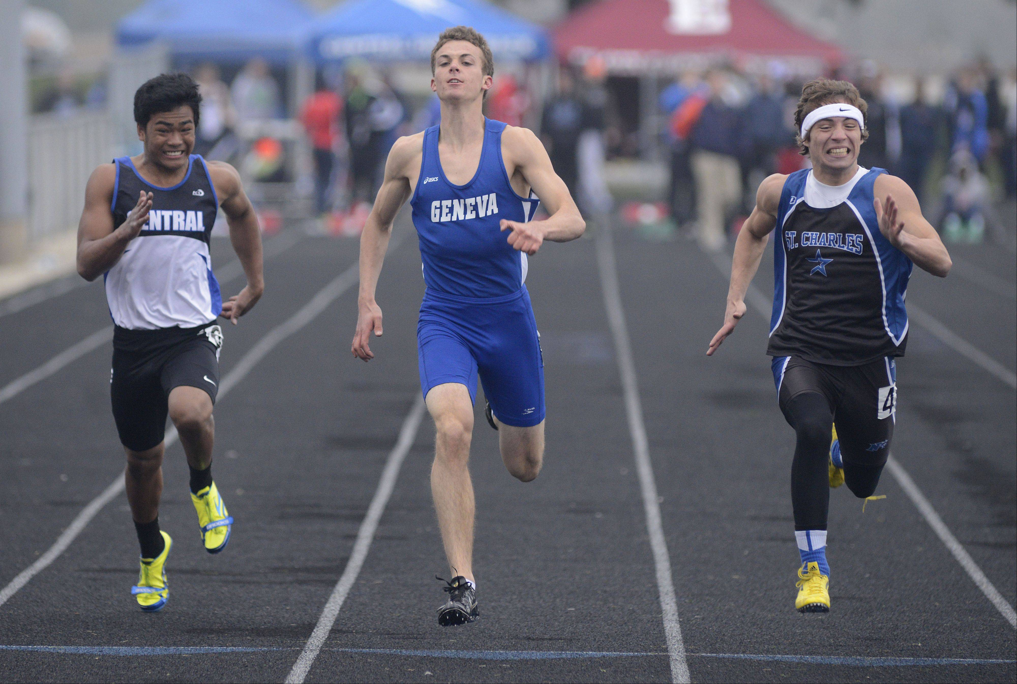 Burlington Central's Jason Berango, Geneva's Tim Roels and St. Charles North's Grant Loess in the 100-meter dash final at the Kane County boys track meet at Burlington Central on Friday.