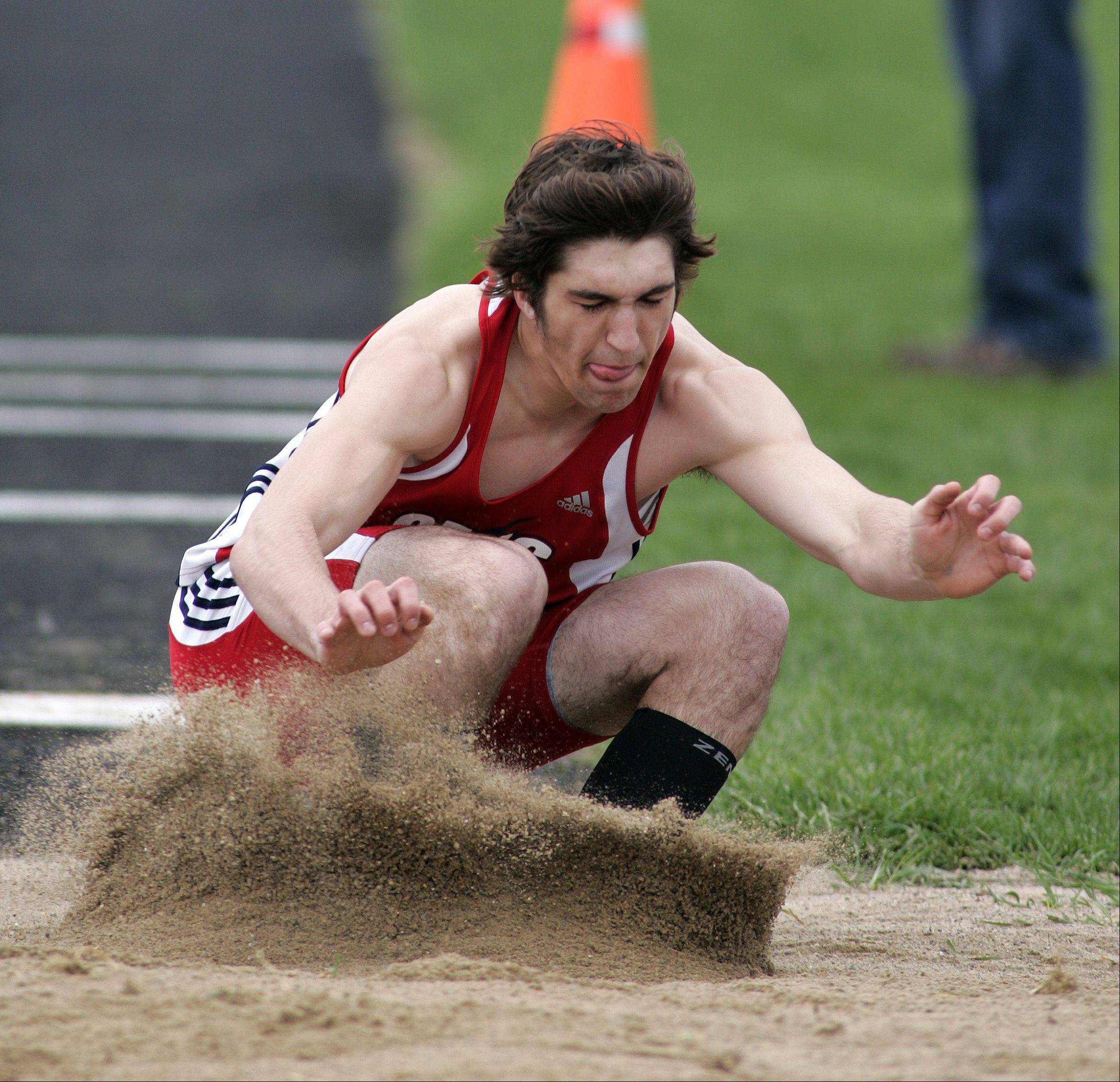Kyle Kumerow of South Elgin competes in the triple jump during the Kane County boys track meet Friday at Burlington Central.