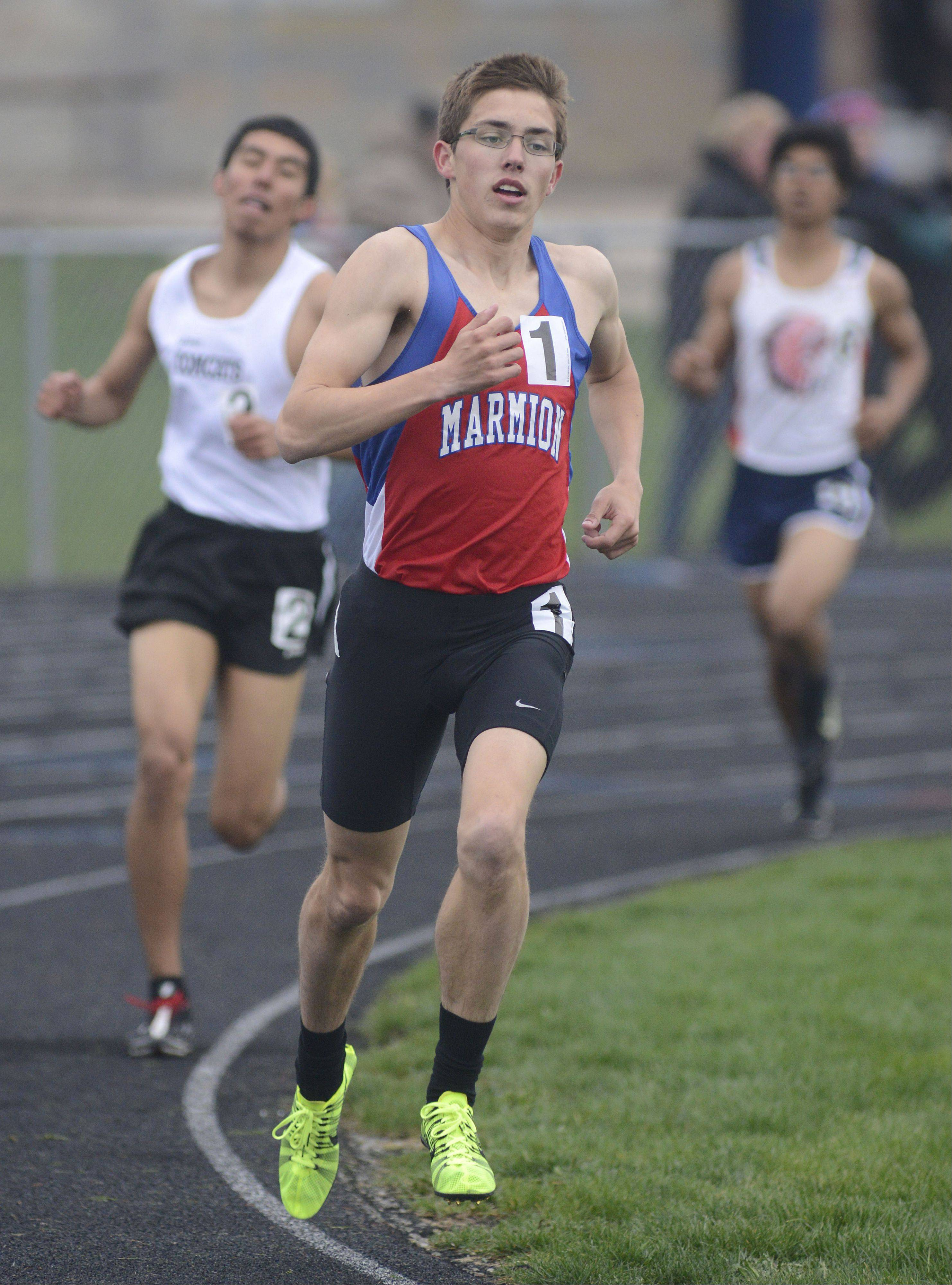 Marmion's John Graft takes the win in the 3,200-meter run at the Kane County boys track meet at Burlington Central on Friday.