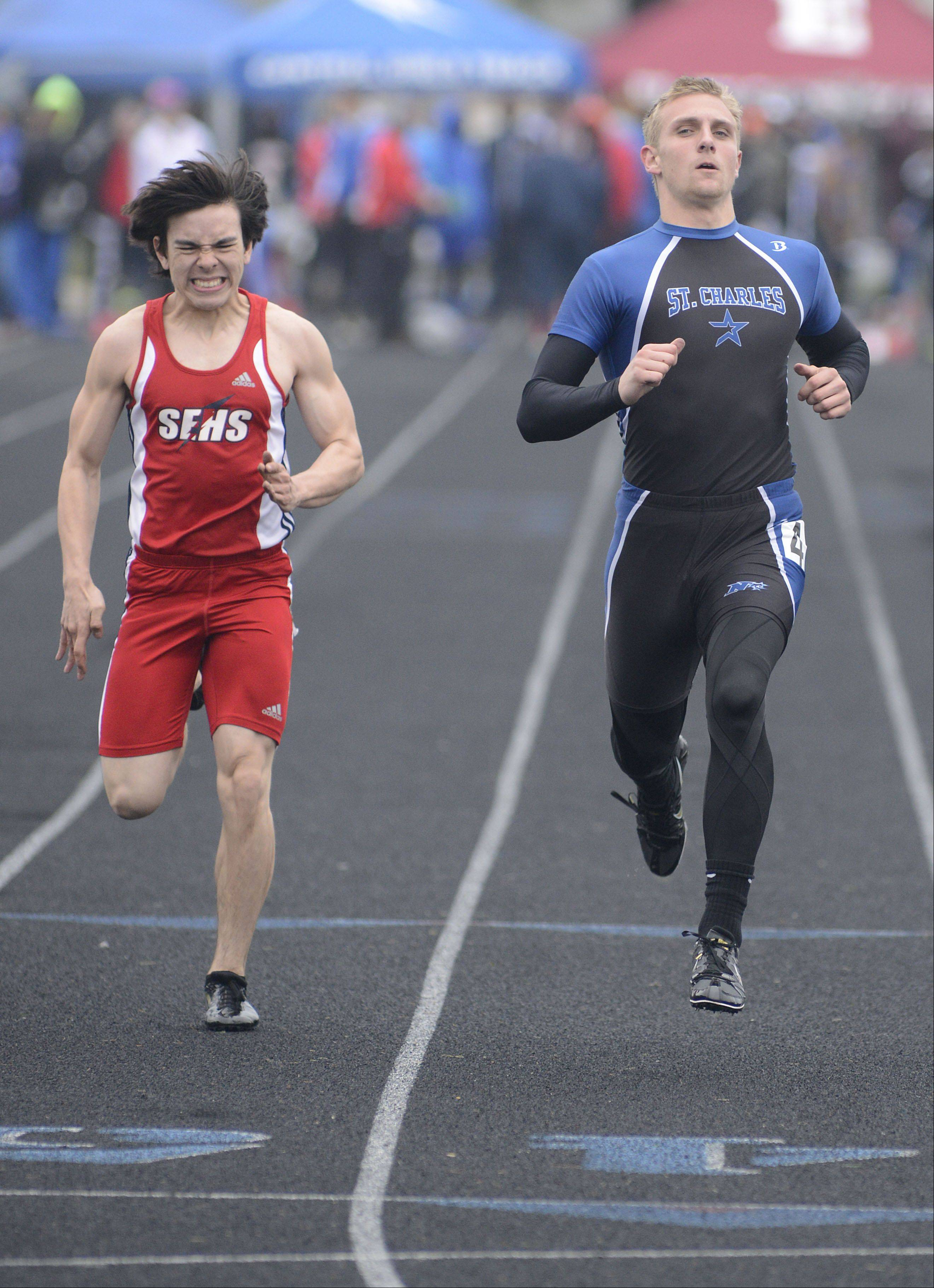 South Elgin's Dan Boice and St. Charles North's Connor Larson in the third heat of the 100-meter dash prelims at the Kane County boys track meet at Burlington Central on Friday.