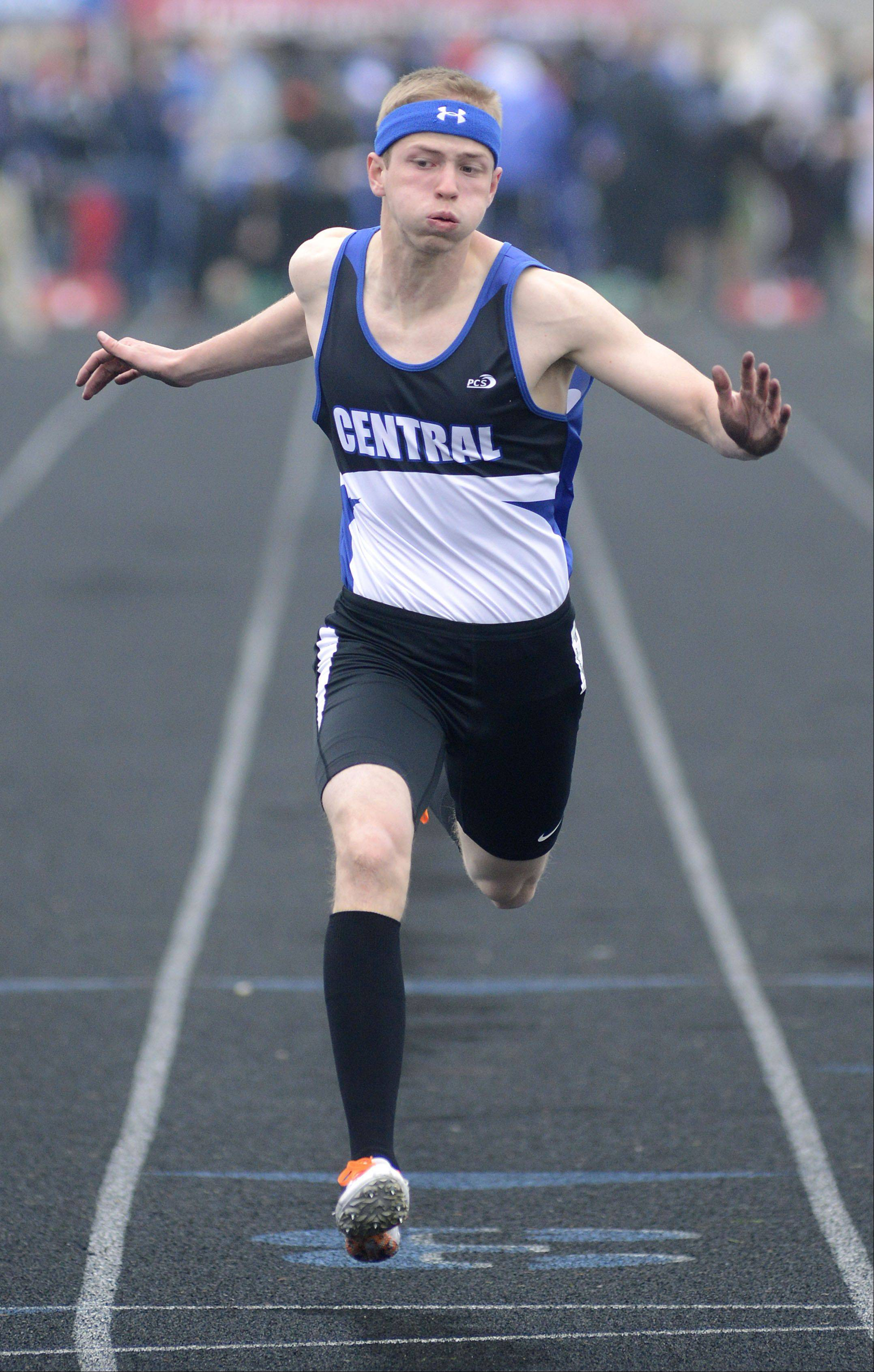 Burlington Central's Ryan Olsen in the second heat of the 100-meter dash prelims at the Kane County boys track meet at Burlington Central on Friday.