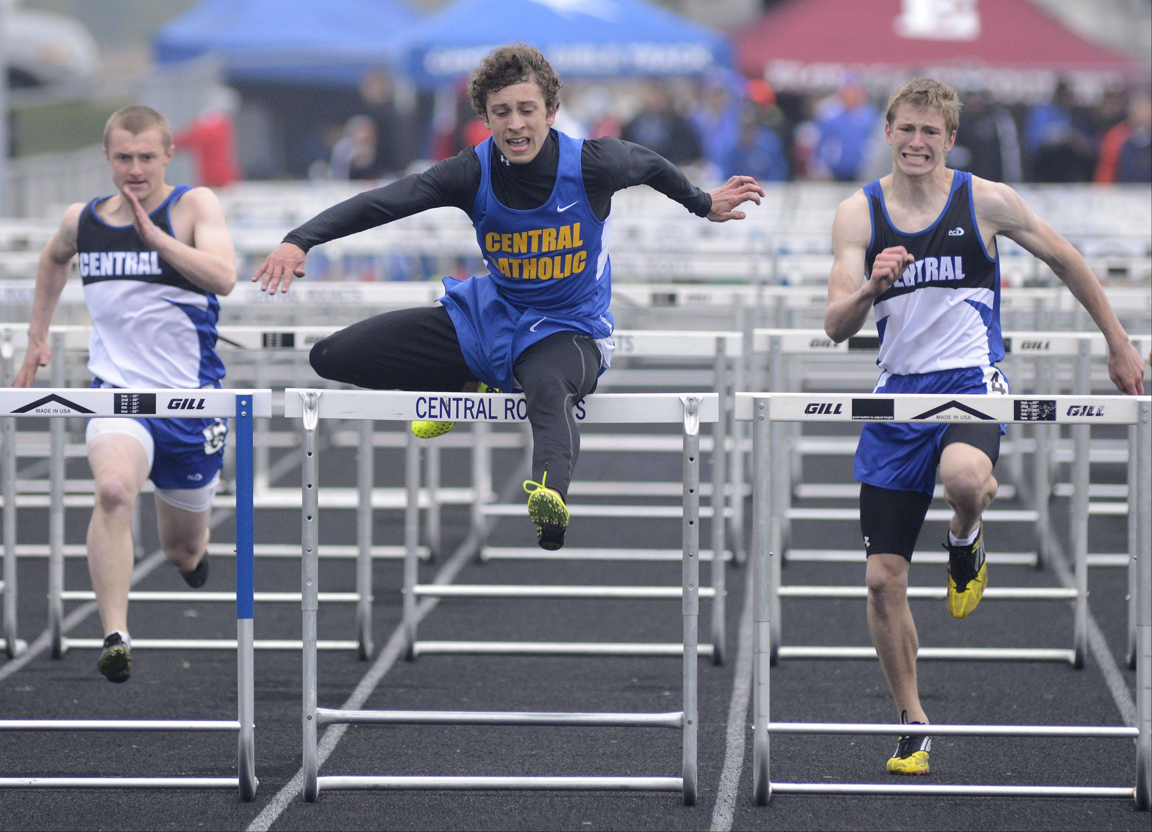 Aurora Central Catholic's Patrick Lefevre wins the 110-meter hurdles final at the Kane County boys track meet at Burlington Central on Friday.