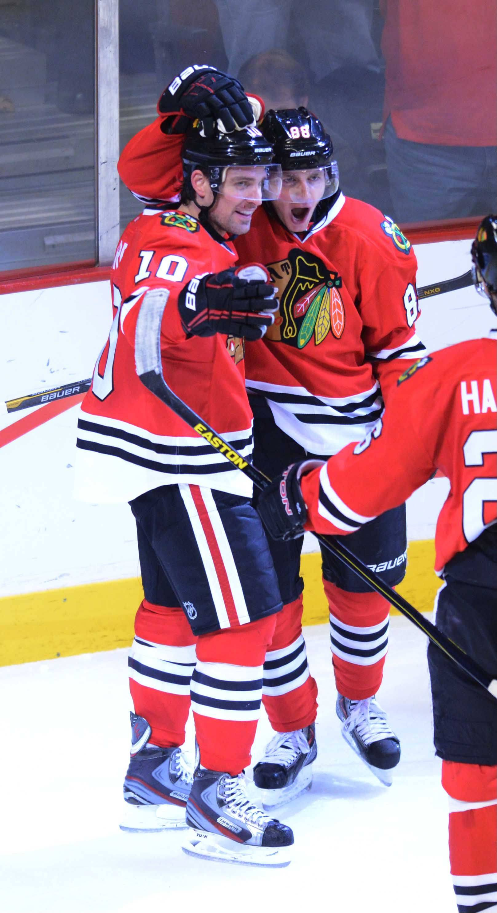 Patrick Sharp, left, and Patrick Kane celebrate a Hawks goal late in the third period. With the 5-2 win over the Minnesota Wild on Friday, the Hawks hit the road with a 2-0 series lead.