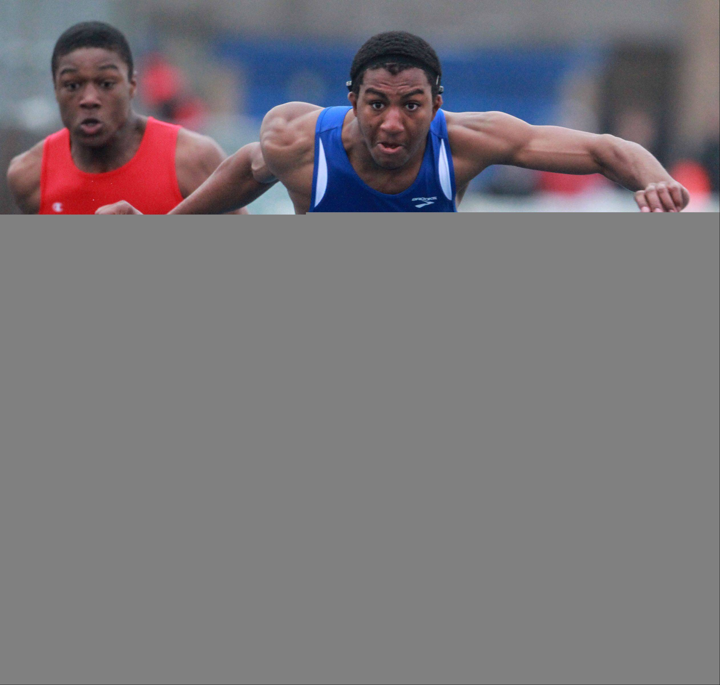 Warren's Myles Garner takes first in the 110-meter hurdles in the Lake County boys track meet at Lake Zurich on Friday.