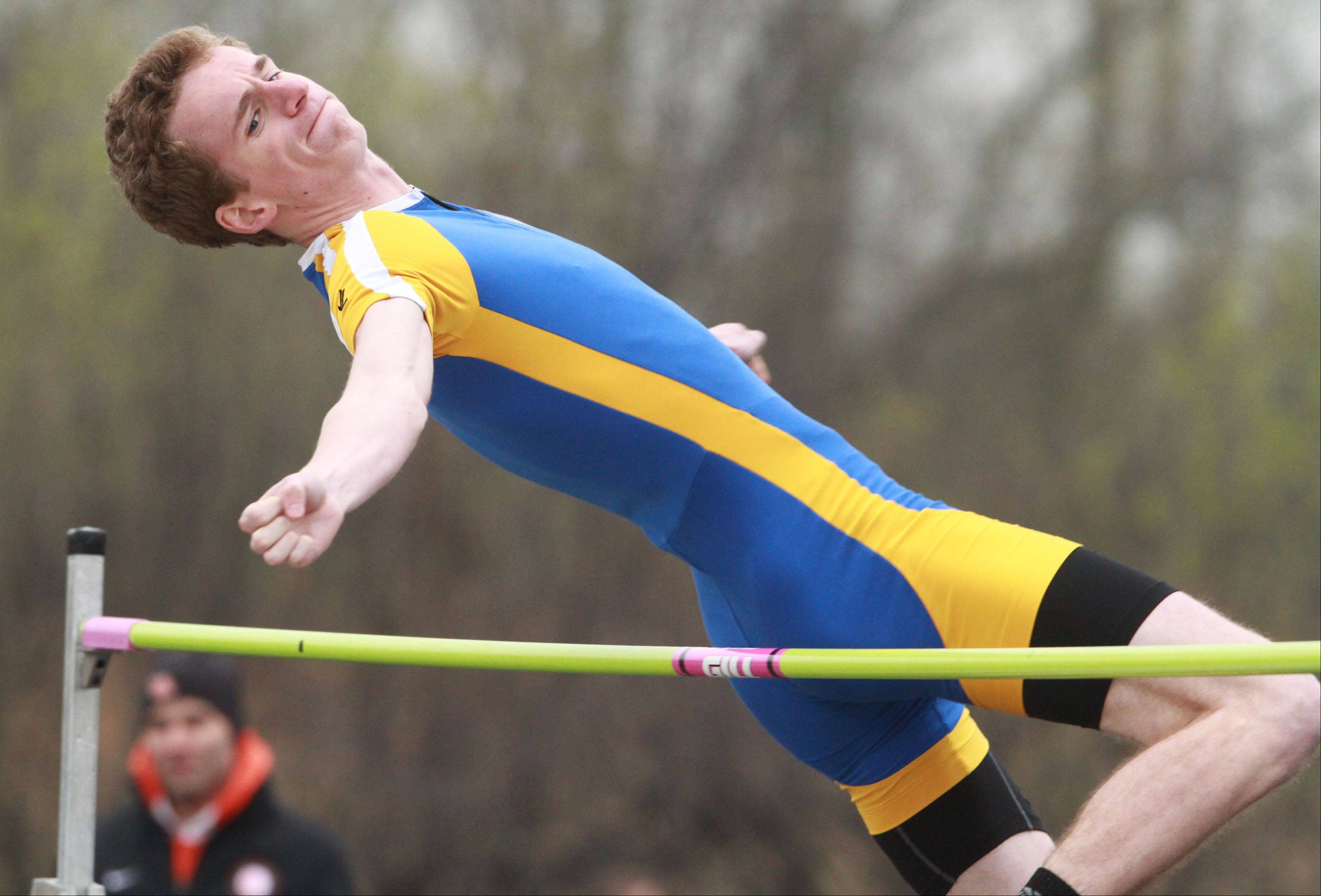 Lake Forest's Carson Sperry competes in the high jump in the Lake County boys track meet at Lake Zurich on Friday.