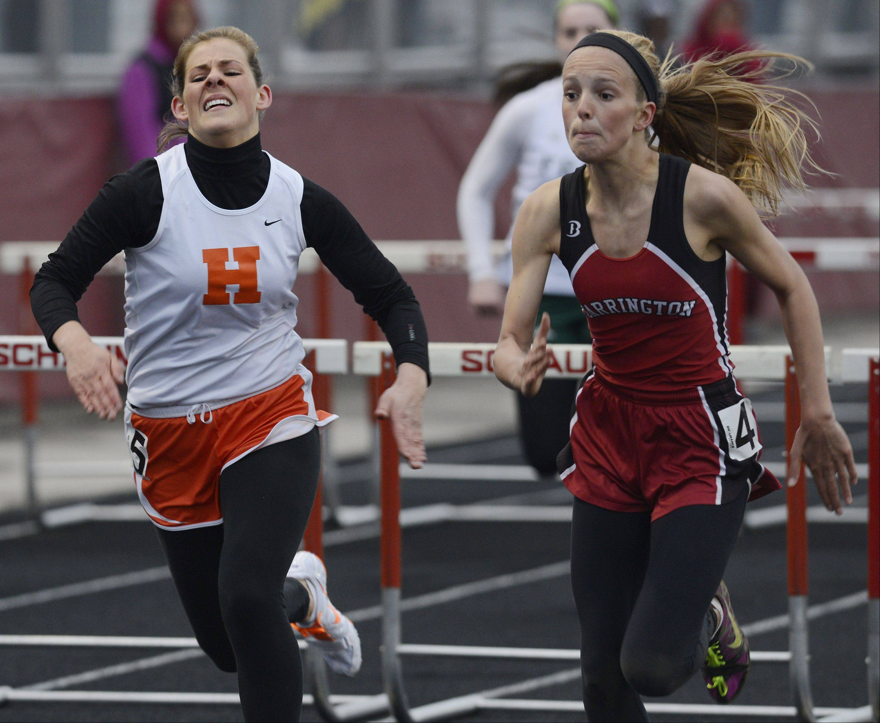Barrington's McCall Braun, right, finishes just ahead of Hersey's Michelle Brown in the 110-meter high hurdles during the Mid-Suburban League girls track meet at Schaumburg on Friday.
