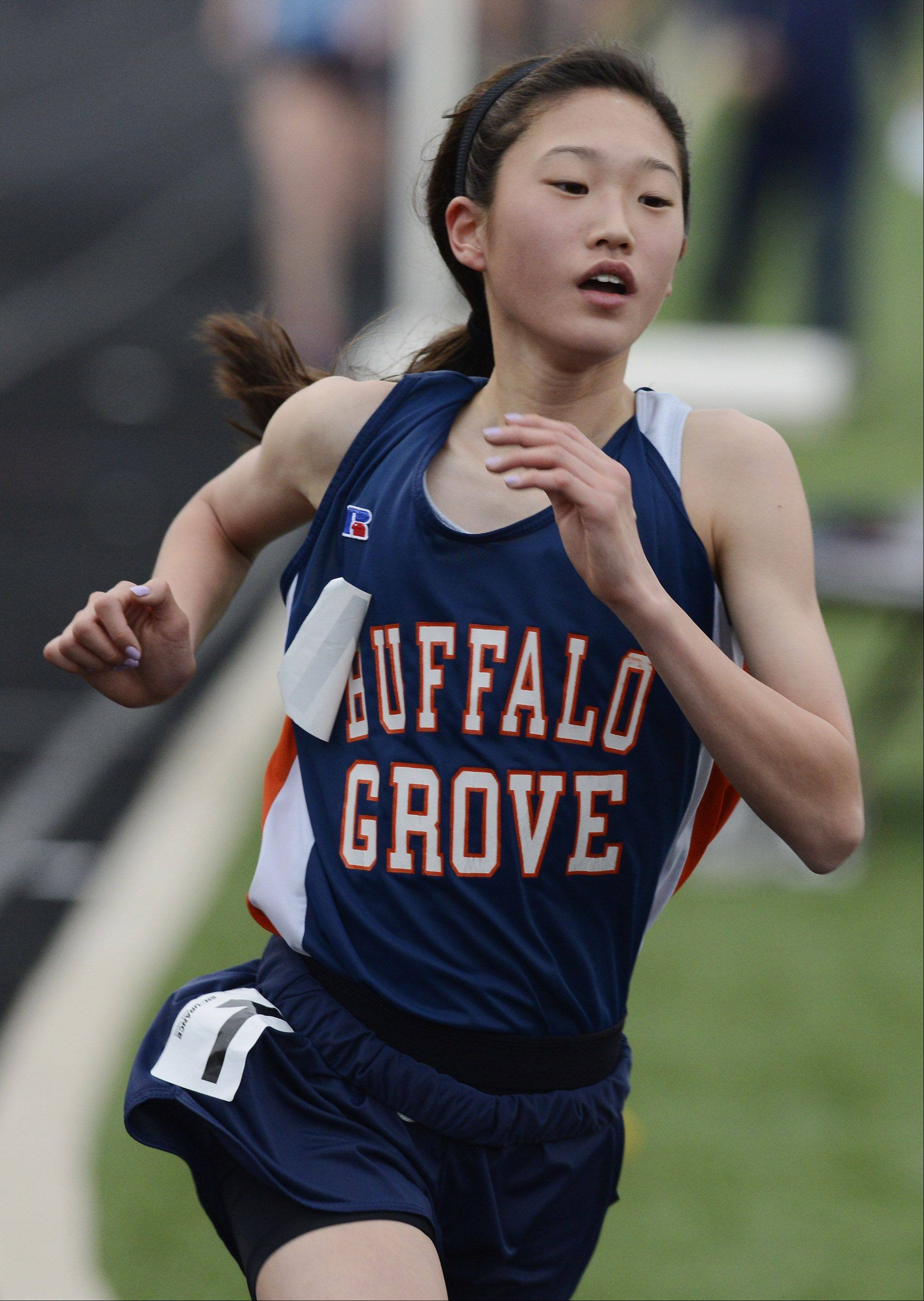 Buffalo Grove's Kaitlyn Ko heads into the final lap on her way to winning the 3,200-meter run during the Mid-Suburban League girls track meet at Schaumburg on Friday.