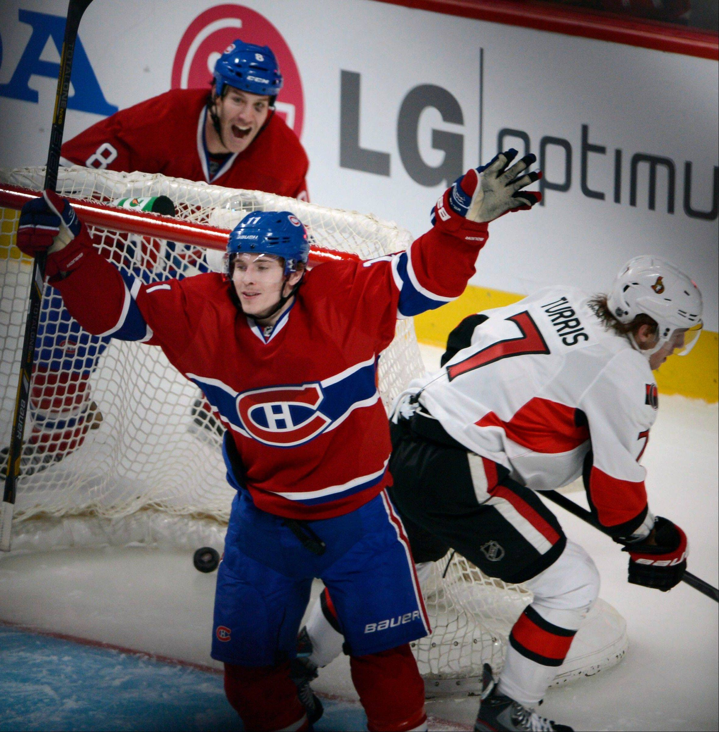 Montreal Canadiens forward Brendan Gallagher celebrates scoring as teammate Brandon Prust (8) and Ottawa Senators forward Kyle Turris (7) look on during second-period NHL hockey Game 2 first-round playoff action in Montreal, Friday, May 3, 2013.