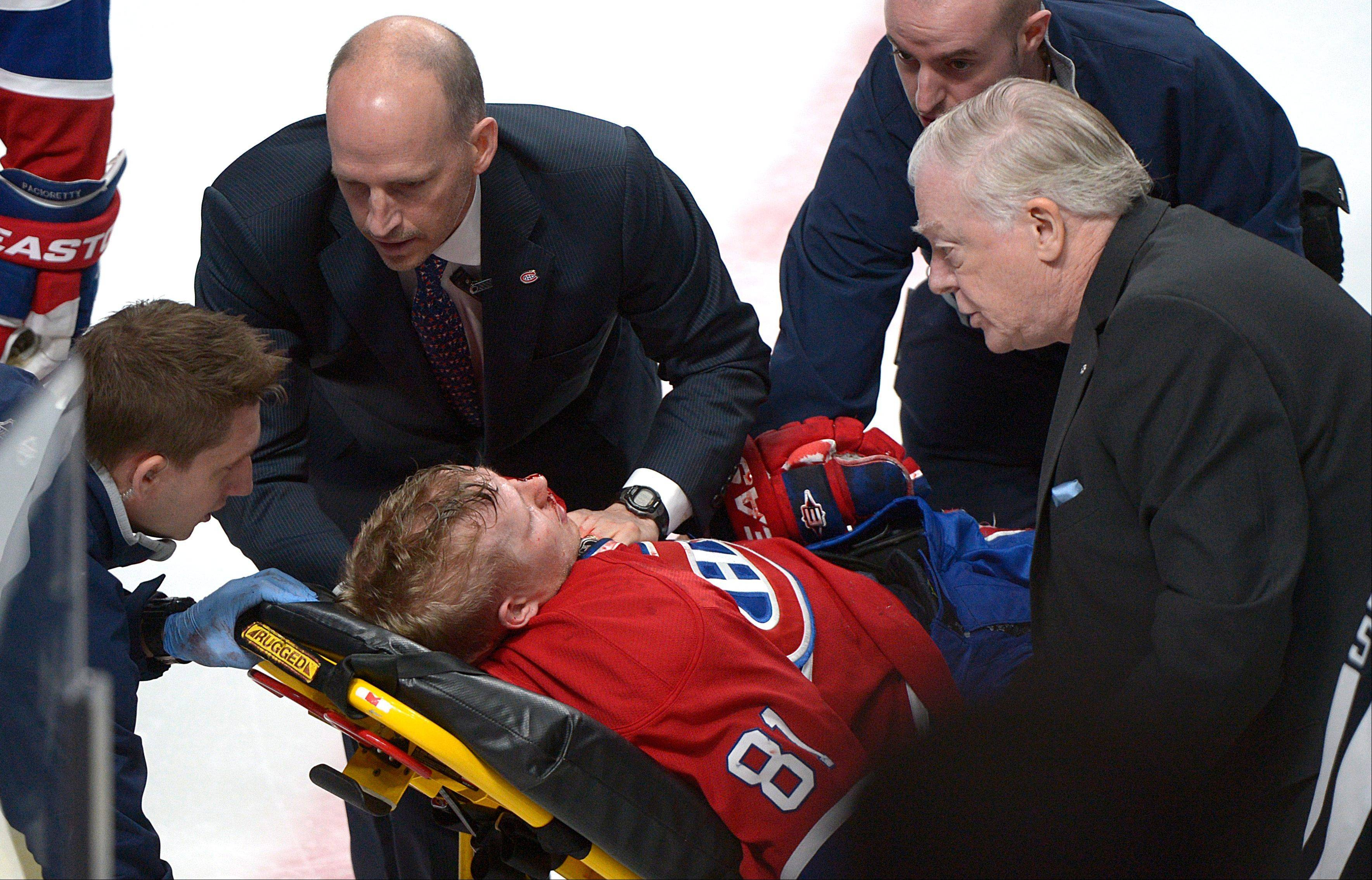 Montreal Canadiens' Lars Eller is taken off the ice Thursday following a hit by Ottawa Senators' Eric Gryba during second period play in Montreal. Eller suffered a concussion and facial fractures.