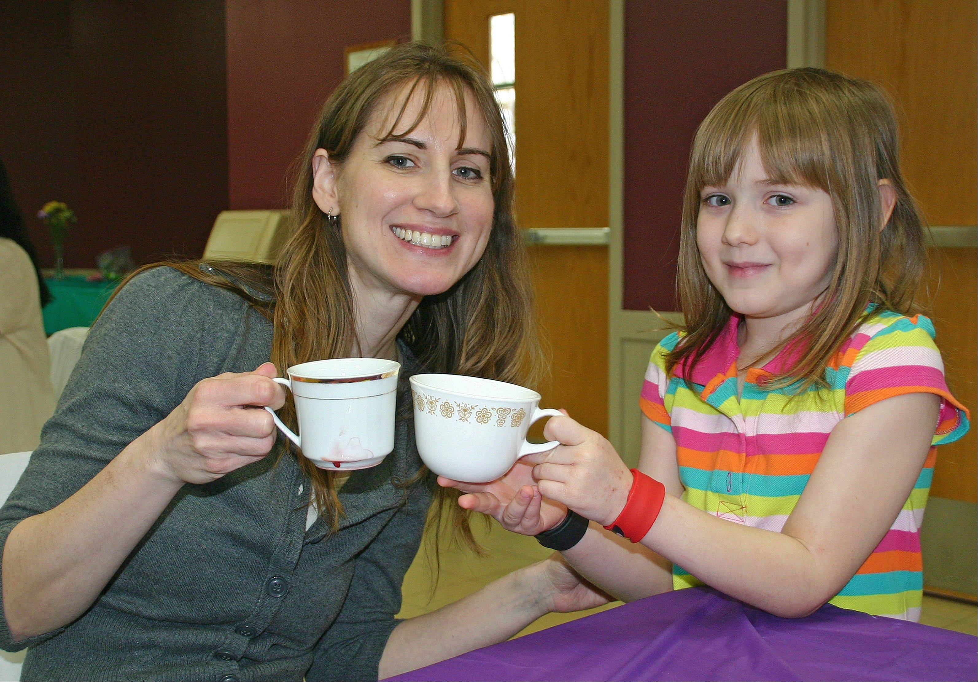Laura and Katelyn Dahl share a cuppa' at the April 13 Mother Daughter Tea at Prairie Lakes.