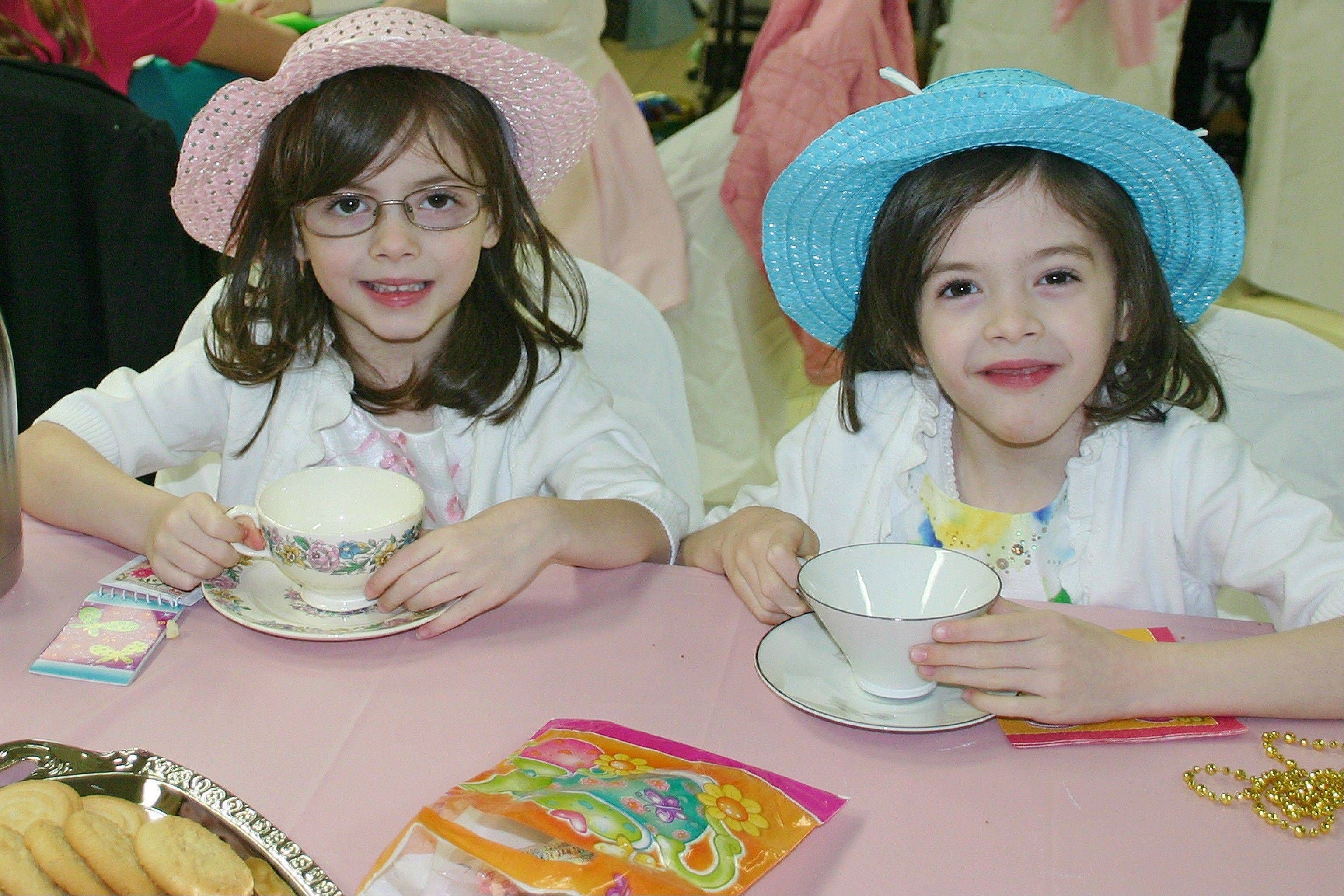 Twins Delaney and Lyra Bishop enjoy a spot o' tea at the Mother Daughter Tea on April 13.