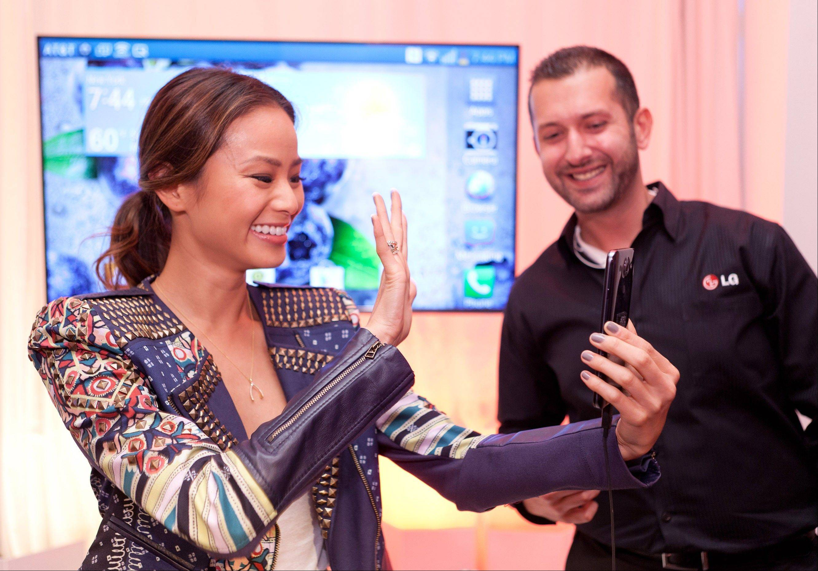 Actress Jamie Chung tries out the LG Optimus G phone with Hamed Nusraty during the Wednesday launch.Nearly 100 wireless companies across 43 countries participate in the overseas database for reported stolen mobile phones.