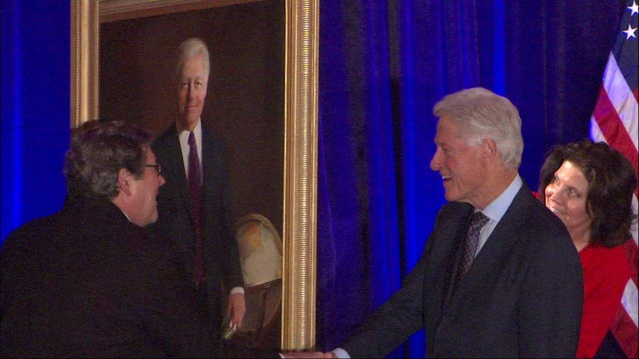 Former President Bill Clinton is presented with a portrait of him created by Arlington Heights artist Bill Chambers. Clinton was awarded the 2013 Lincoln Leadership Prize on Saturday night at the Hilton Chicago.