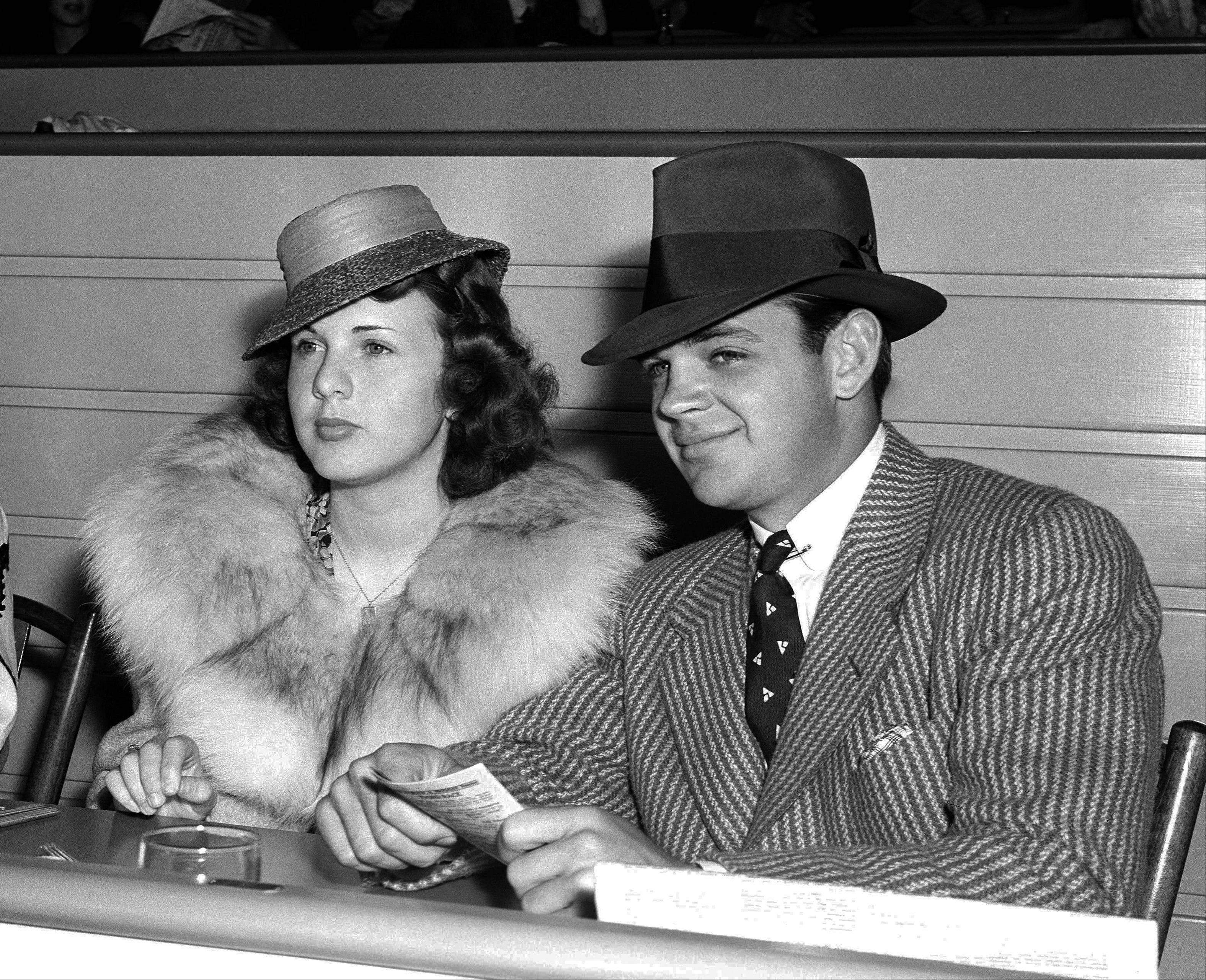 Actress Deanna Durbin sits with Vaughn Paul in the clubhouse of Hollywood Park in Los Angeles. Paul was Durbin�s first husband.