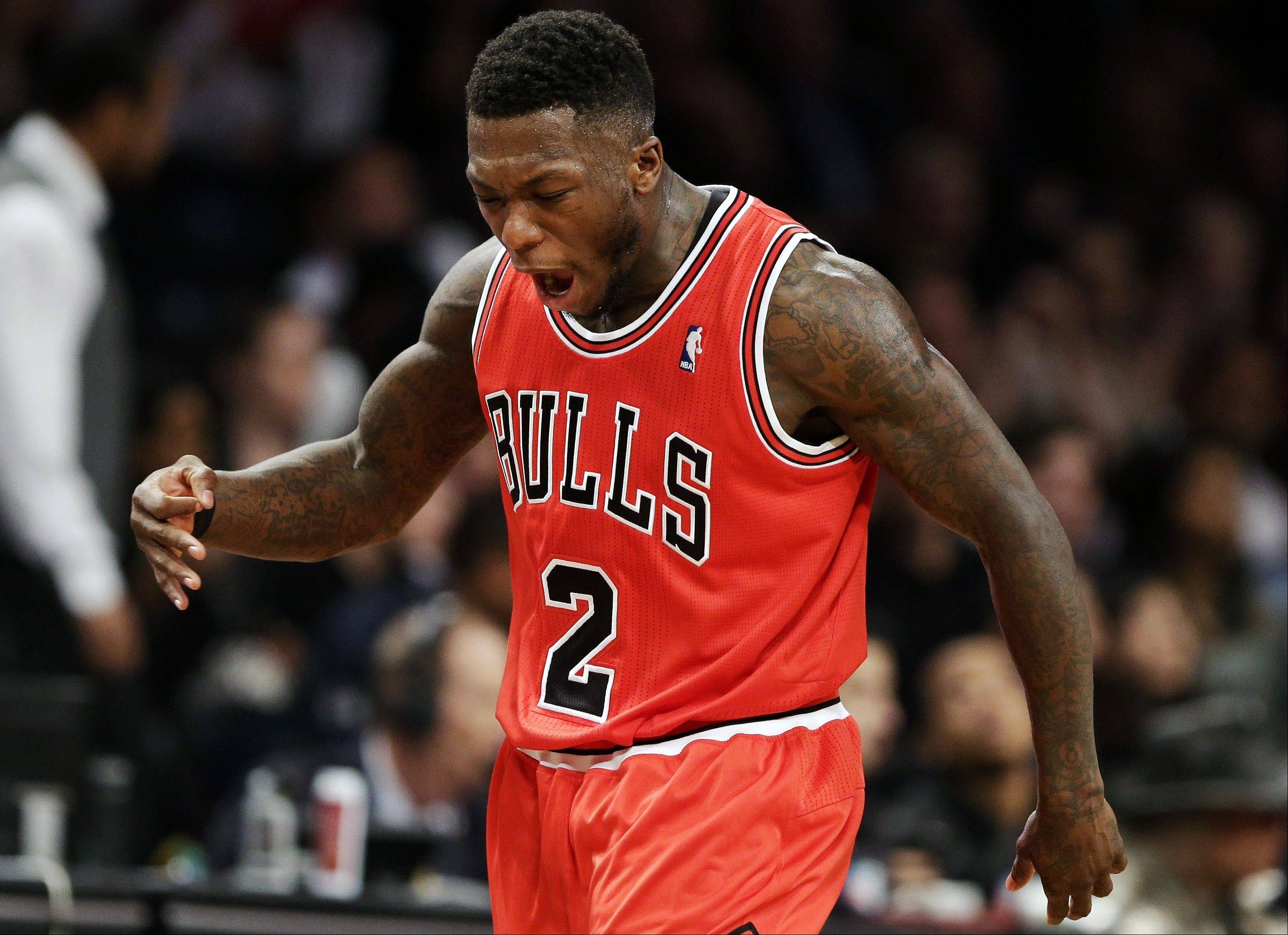 Chicago Bulls guard Nate Robinson reacts after scoring a 3-point shot against the Brooklyn Nets during the first half in Game 7 of their first-round NBA basketball playoff series in New York, Saturday, May 4, 2013.