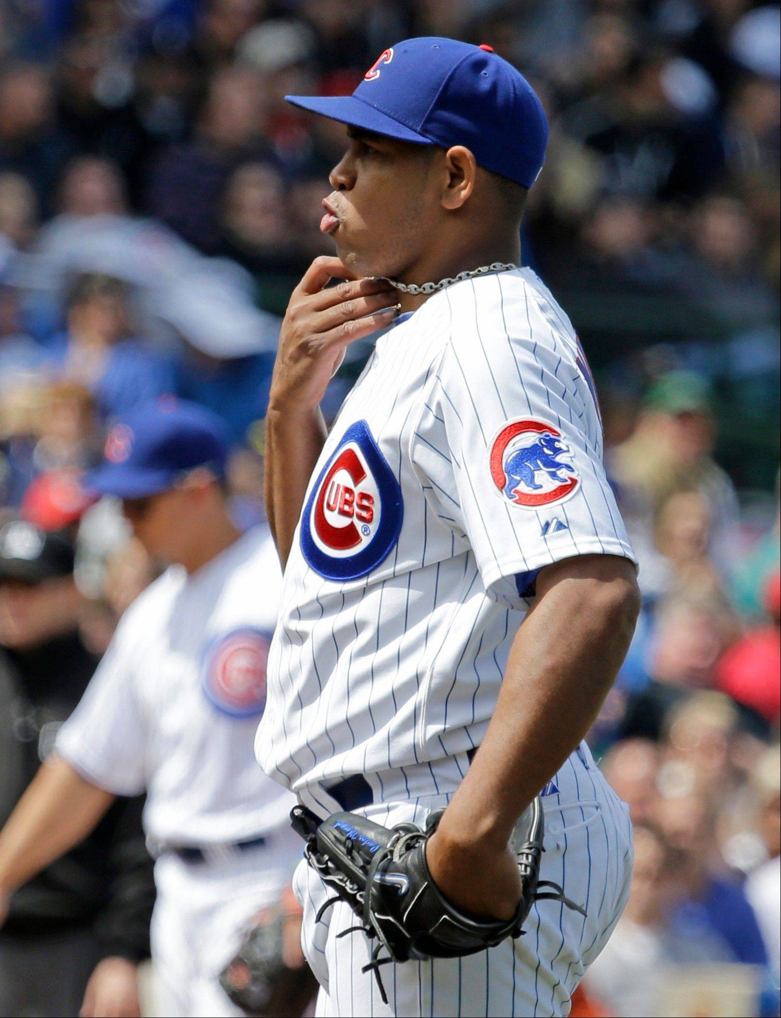 Carlos Marmol reacts reacts after he walked Joey Votto during the eighth inning Saturday at Wrigley Field. Marmol has walked 12 and hit three batters in just 112⁄3 innings.