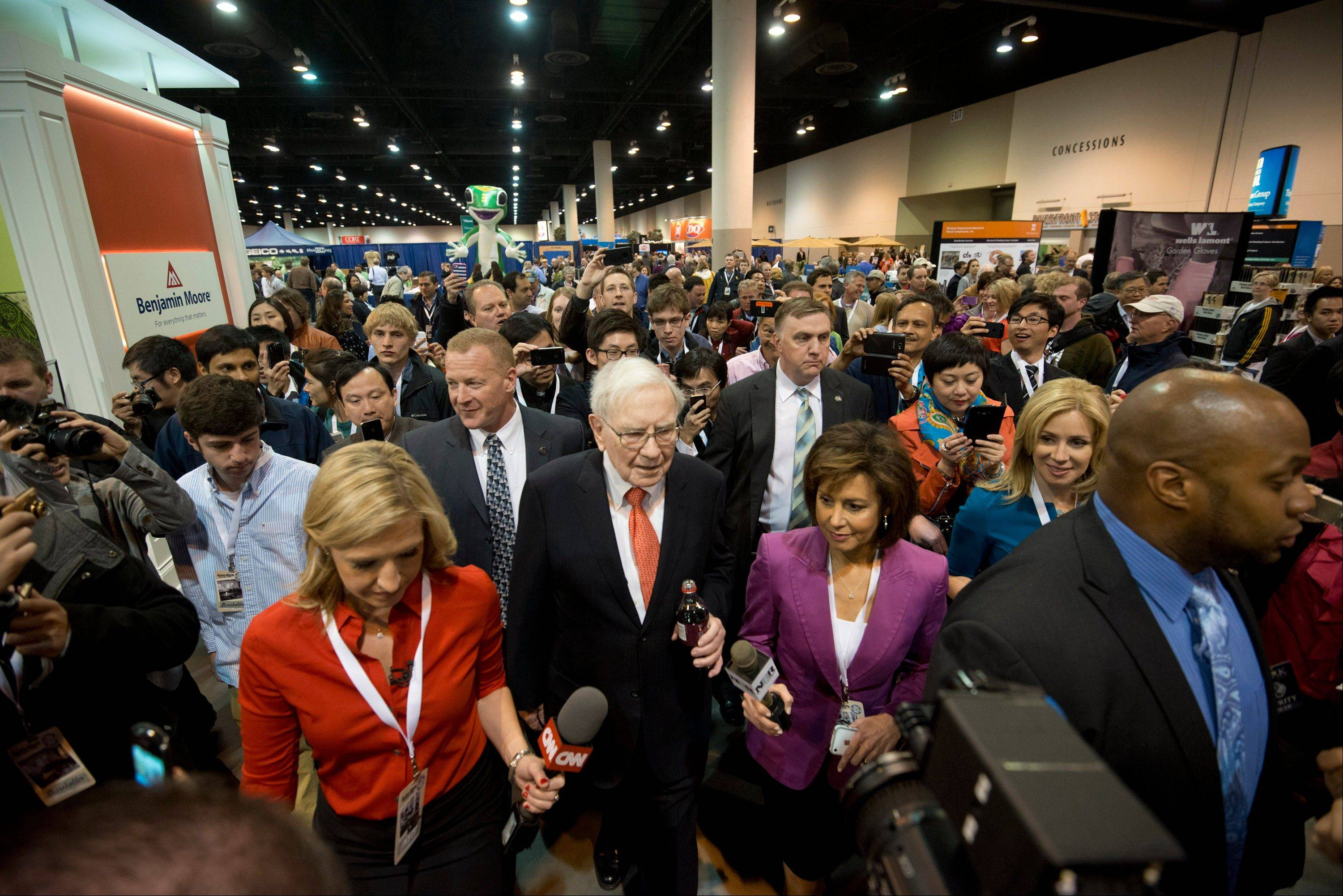 Warren Buffett, chairman and chief executive officer of Berkshire Hathaway Inc., tours the exhibition floor Saturday prior to the start of the Berkshire shareholders meeting in Omaha, Nebraska.