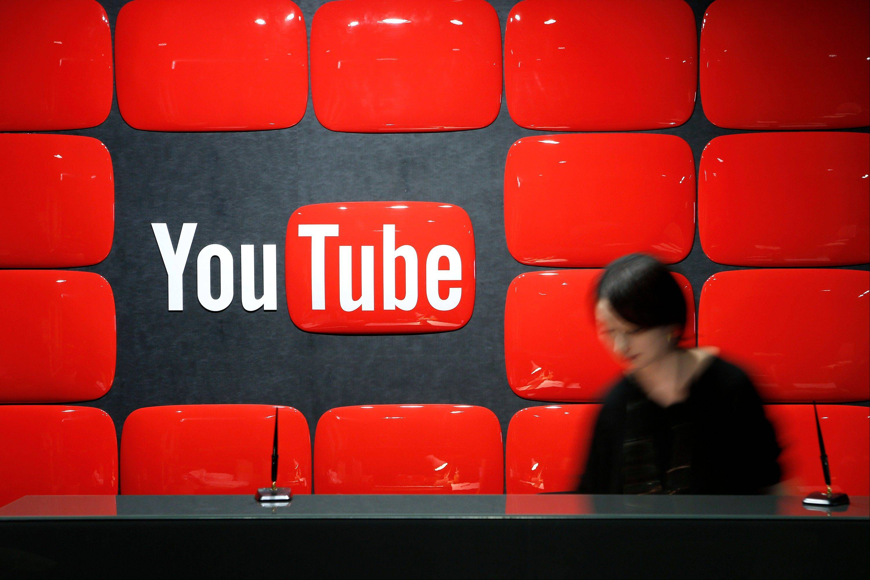 Google Inc.'s YouTube logo is displayed behind the reception desk at the company's YouTube Space studio in Tokyo, Japan, on Saturday, March 30, 2013. In Japan, YouTube's biggest regional success story in Asia, the company is recruiting online stars to bolster its local-language channels with more-targeted original programming and higher production values.