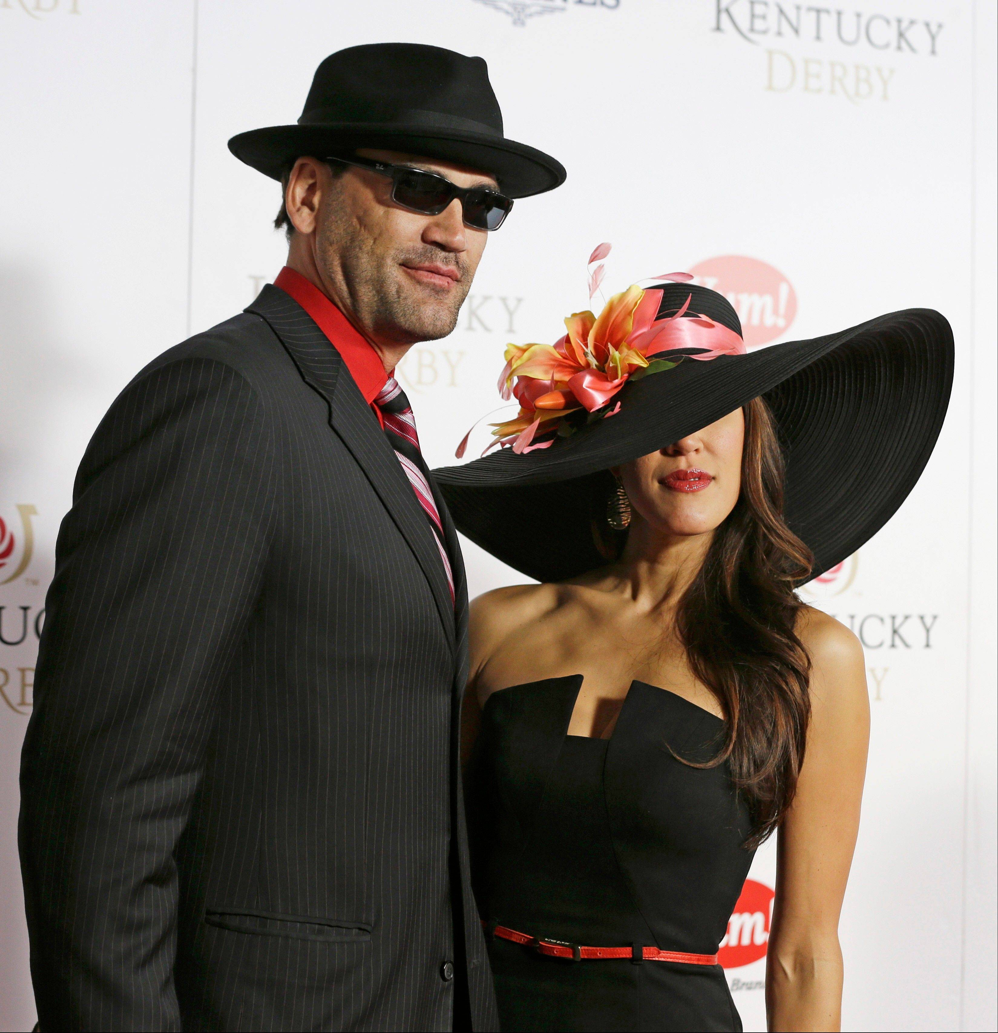 Retired NBA player Scot Pollard arrives with a friend to attend the 139th Kentucky Derby.