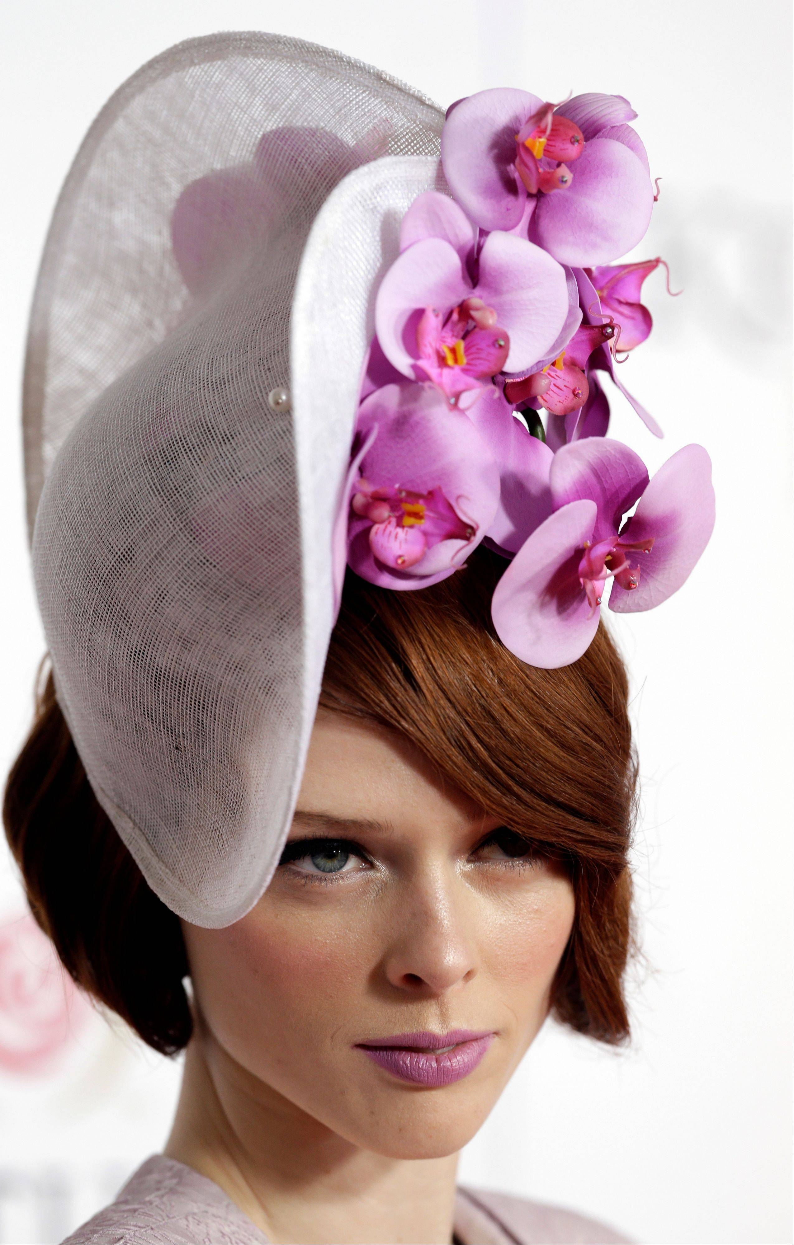 Model Coco Rocha arrives to attend the 139th Kentucky Derby at Churchill Downs Saturday.