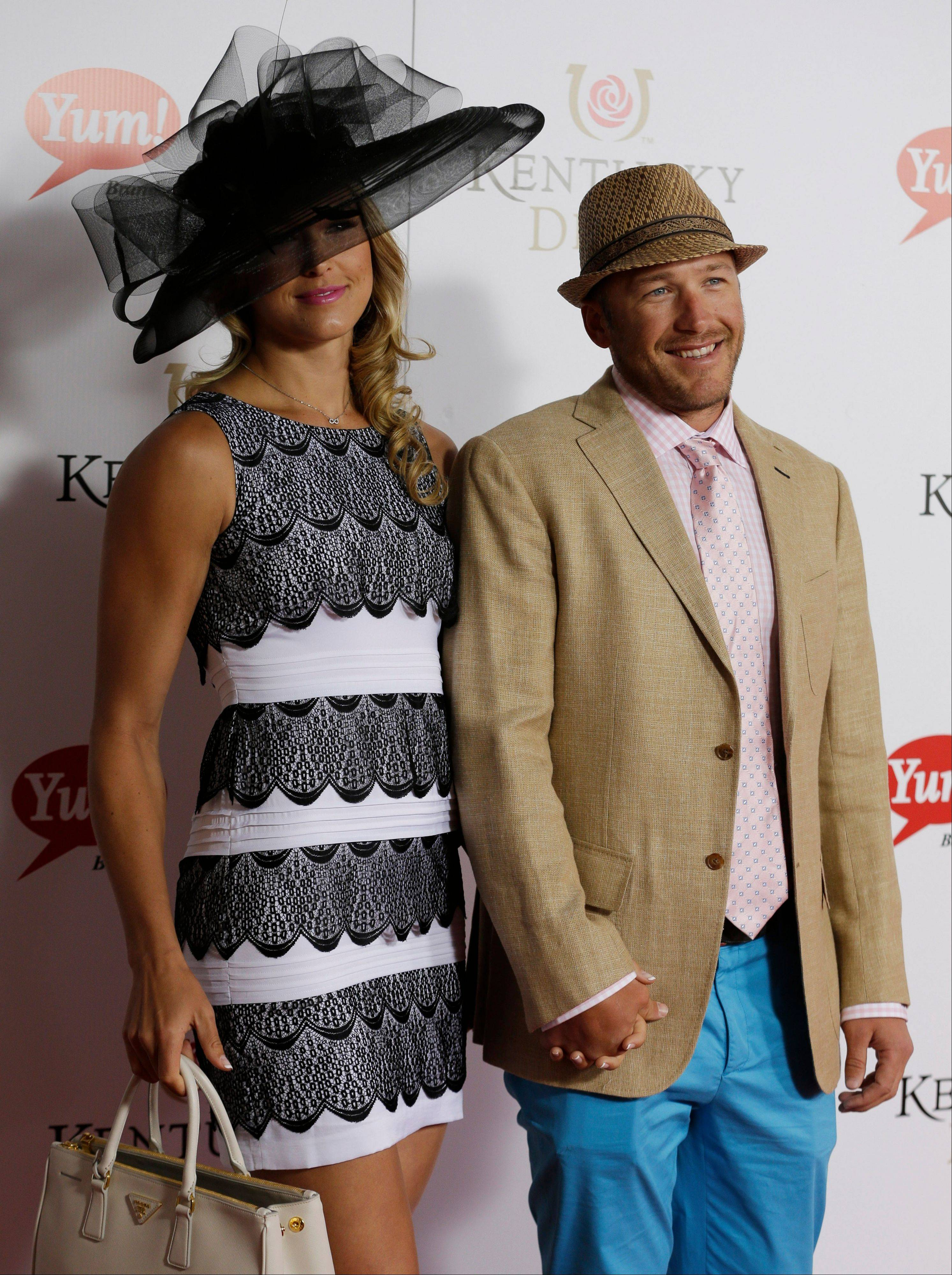 US skier Bode Miller and his wife Morgan arrive to attend the 139th Kentucky Derby.