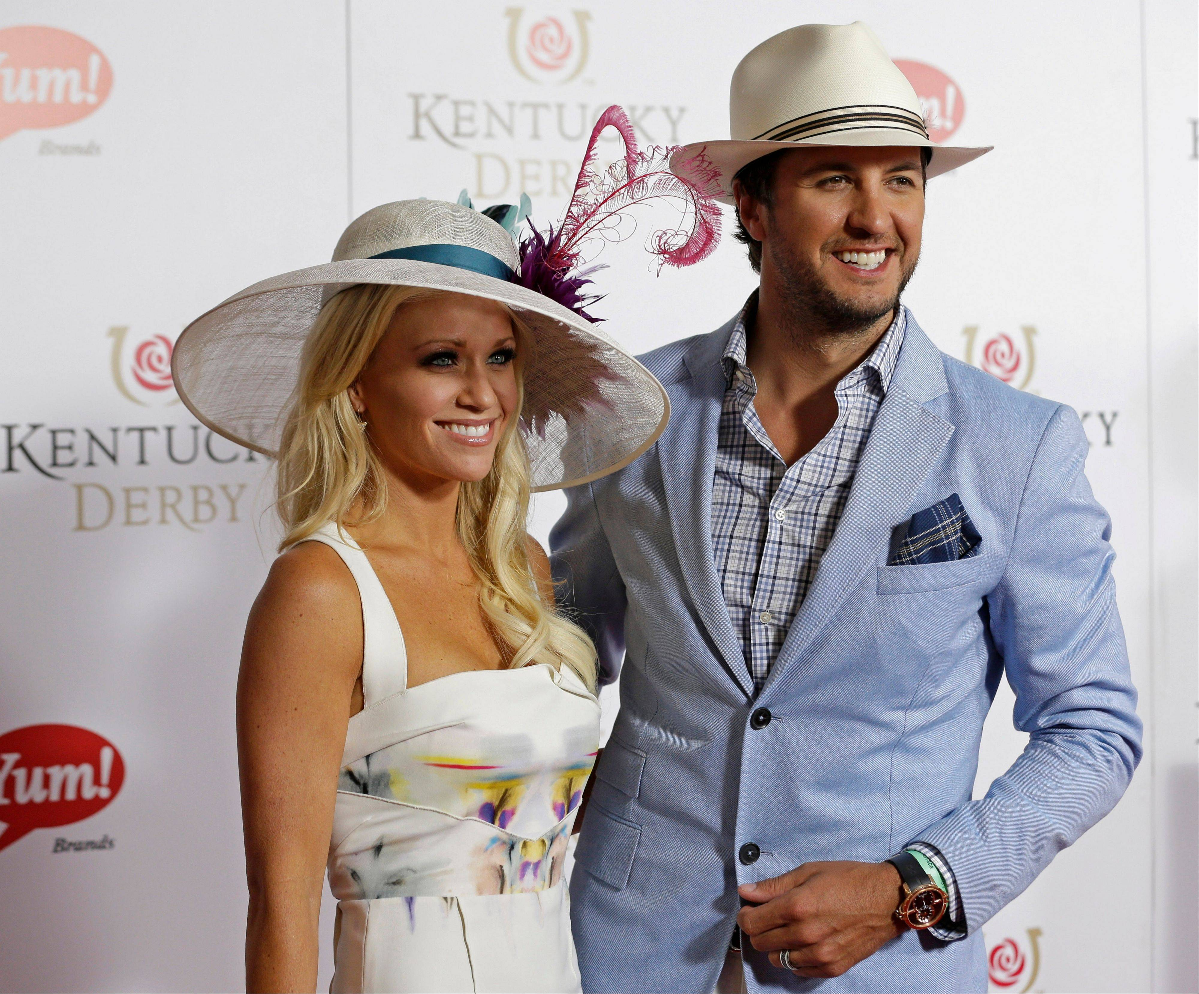 Country singer Luke Bryan arrives with his wife Caroline.