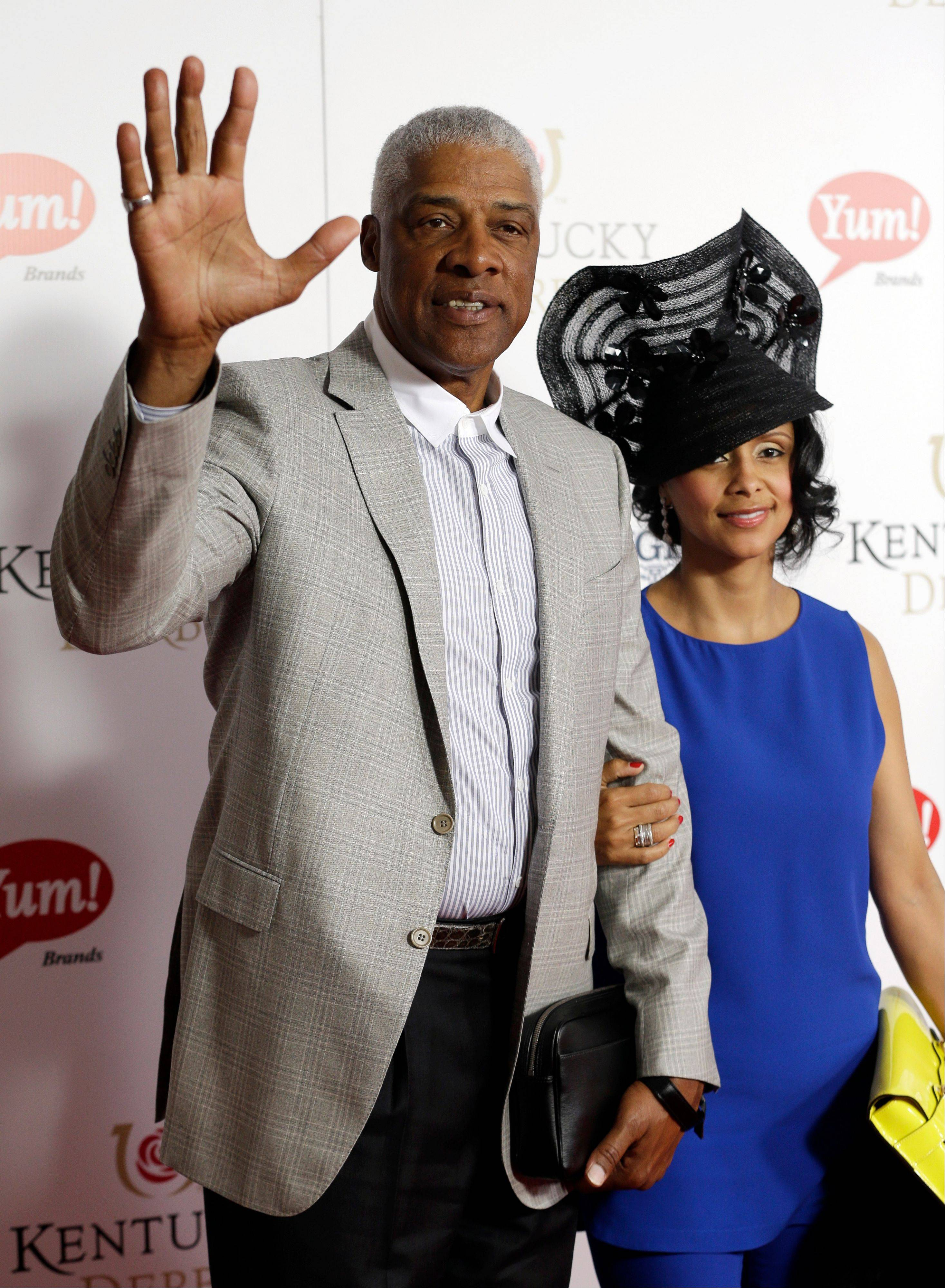 "Former NBA player Julius ""Dr. J"" Irving arrives with his wife Dorys to attend the 139th Kentucky Derby."
