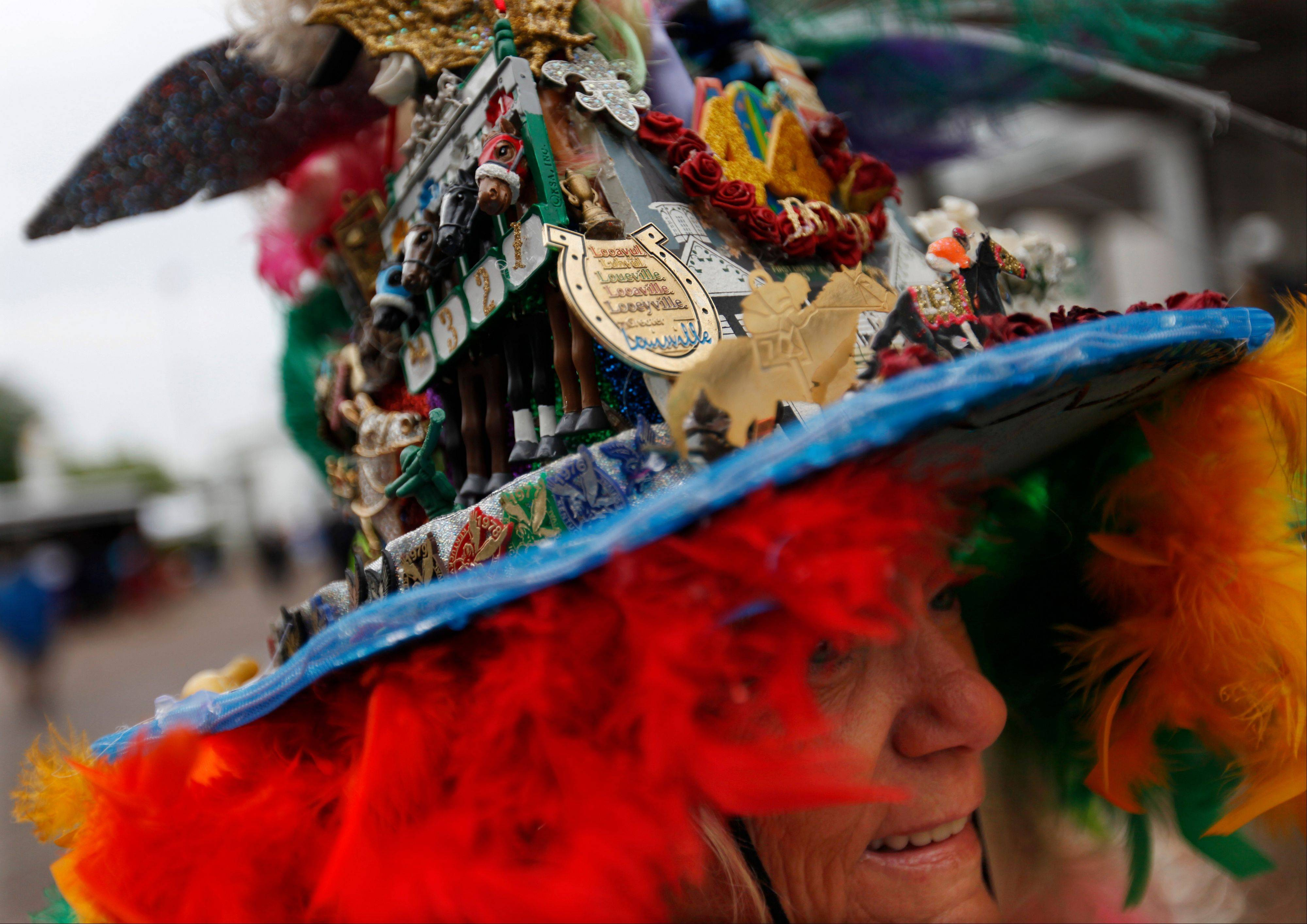 Jinny Keen, from Louisville, Ky., wears a handmade hat, celebrating her 44th Derby appearance before the running of the 139th Kentucky Derby.