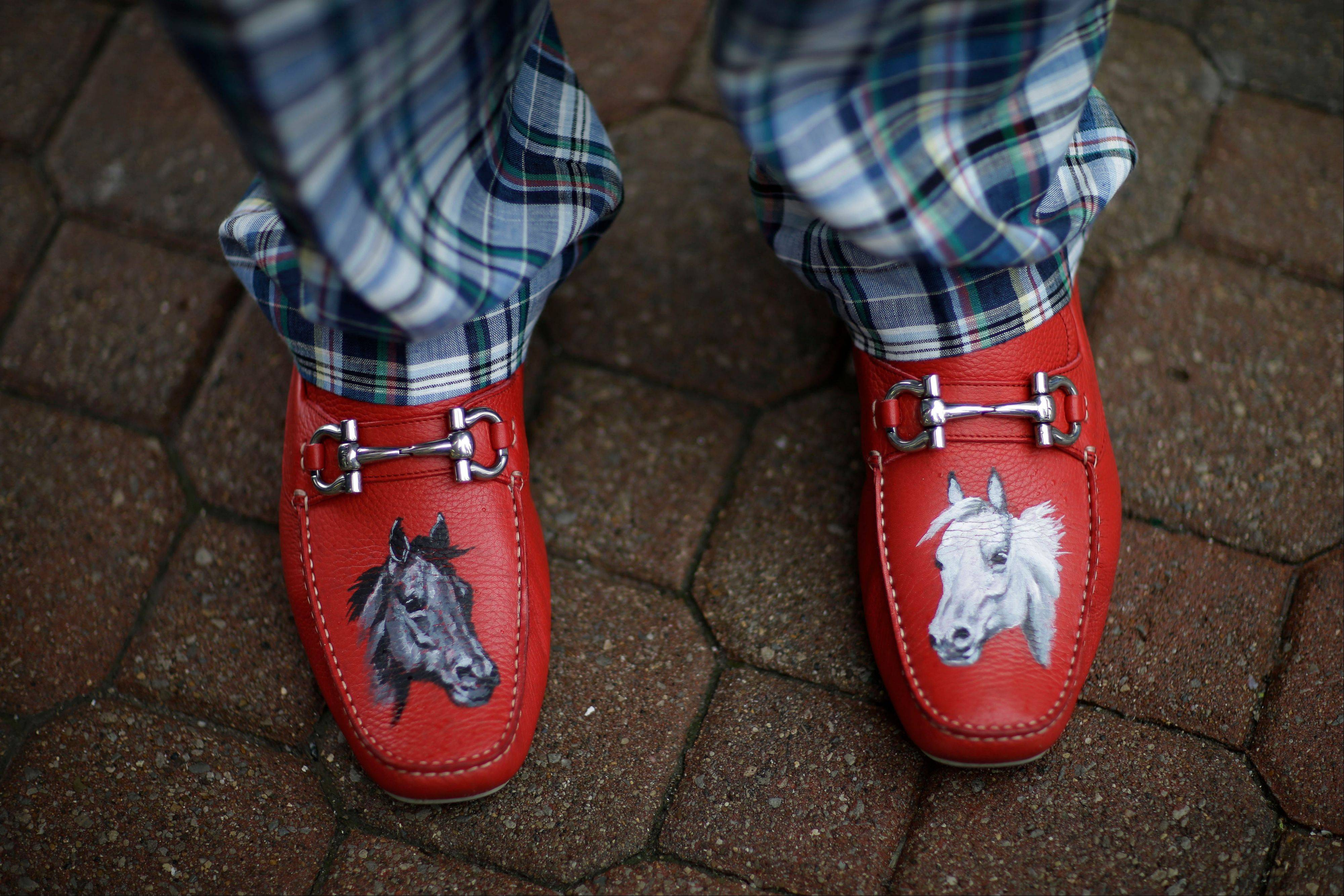 James Cowheard, from Las Vegas, Nev., shows off his fancy shoes before the running of the 139th Kentucky Derby.