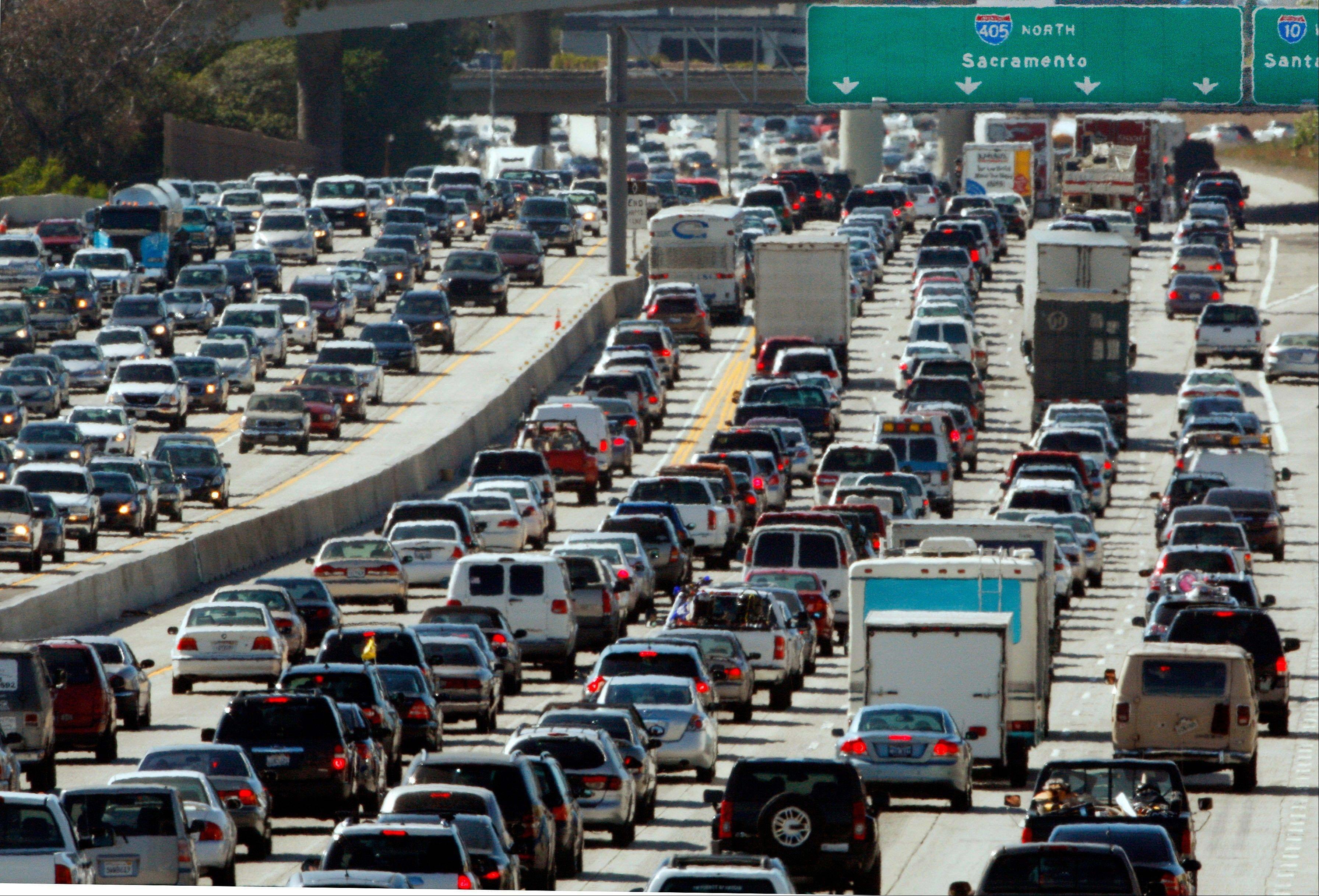 In this May 28, 2010 file photo, the rush hour commute starts in early afternoon and with greater intensity as traffic is jammed in both directions on Interstate 405 on the Westside of Los Angeles as commuters and vacationers hit the road. With a little advance planning, and some insider tips, summer vacations can be a lot less expensive.