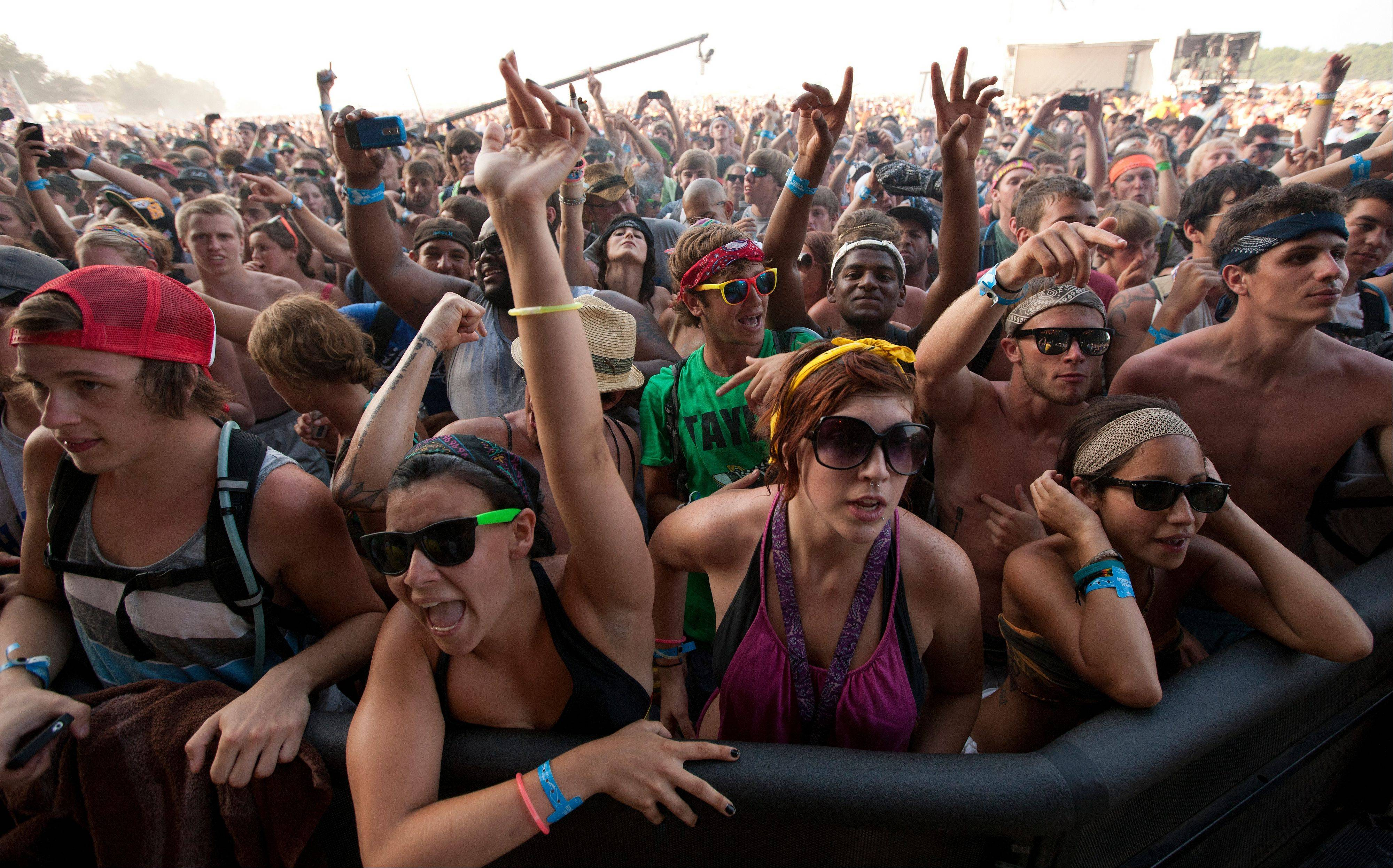 Music fans gather to watch Wiz Khalifa during the Bonnaroo Music and Arts Festival in Manchester, Tenn.
