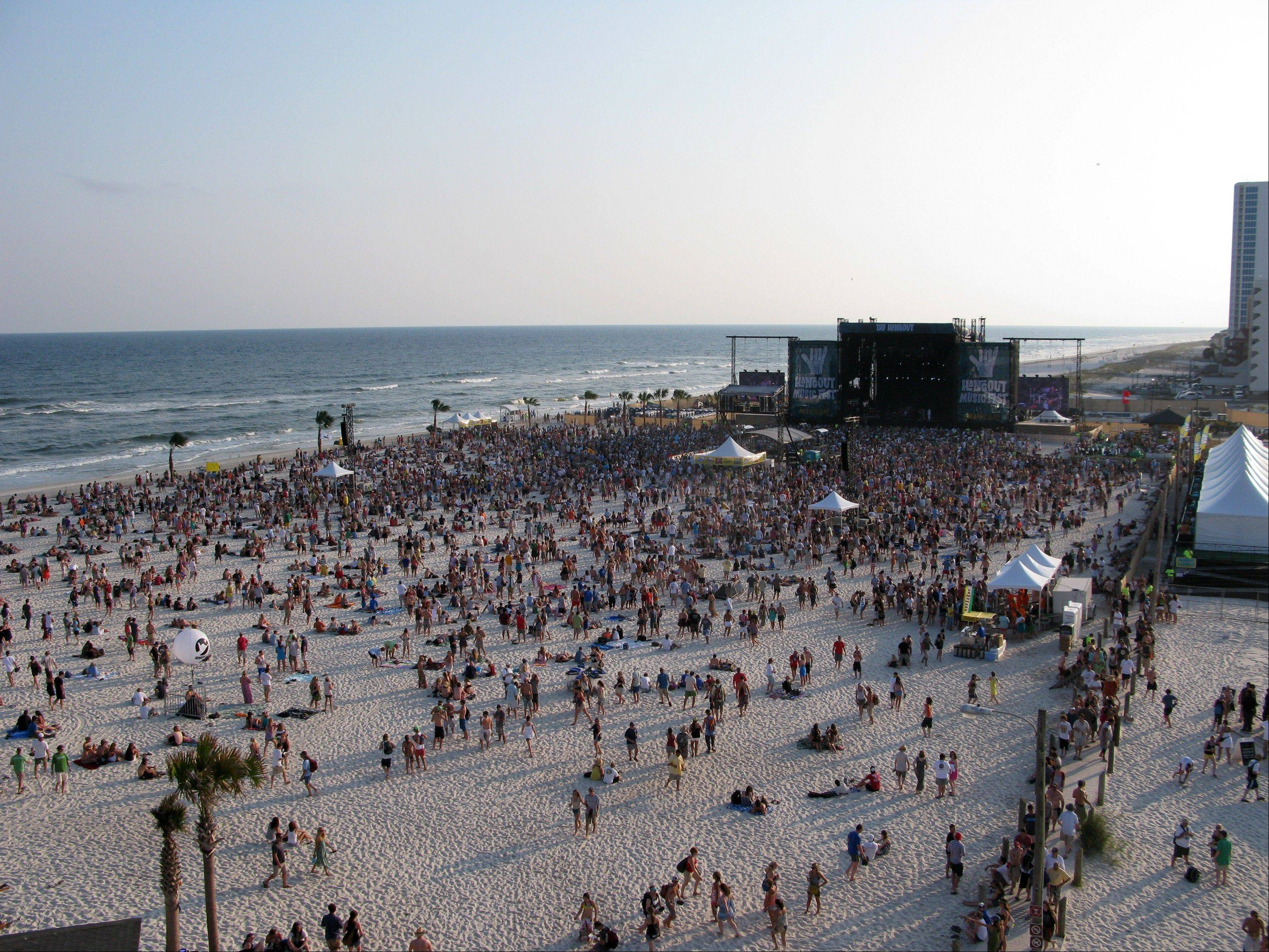 Festival goers enjoy the beach at sunset at the Hangout Music Fest in Gulf Shores, Ala.