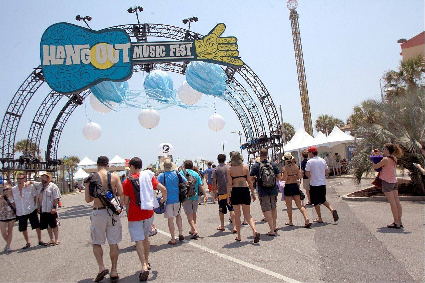 Festival goers arrive for the three-day Hangout Music Festival in Gulf Shores, Ala.
