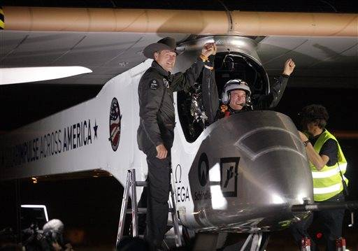 Solar Impulse co-founder, pilot and CEO Andre Borschberg, left, greets pilot Bertrand Piccard at Sky Harbor International Airport in Phoenix, early Saturday, May 4, 2013, after completing the first leg of its coast-to-coast flights across the United States. It is the first time that a solar airplane capable of flying day and night without fuel, will attempt to fly across America. Solar Impulse began its journey Friday in San Francisco in its attempt to reach New York.