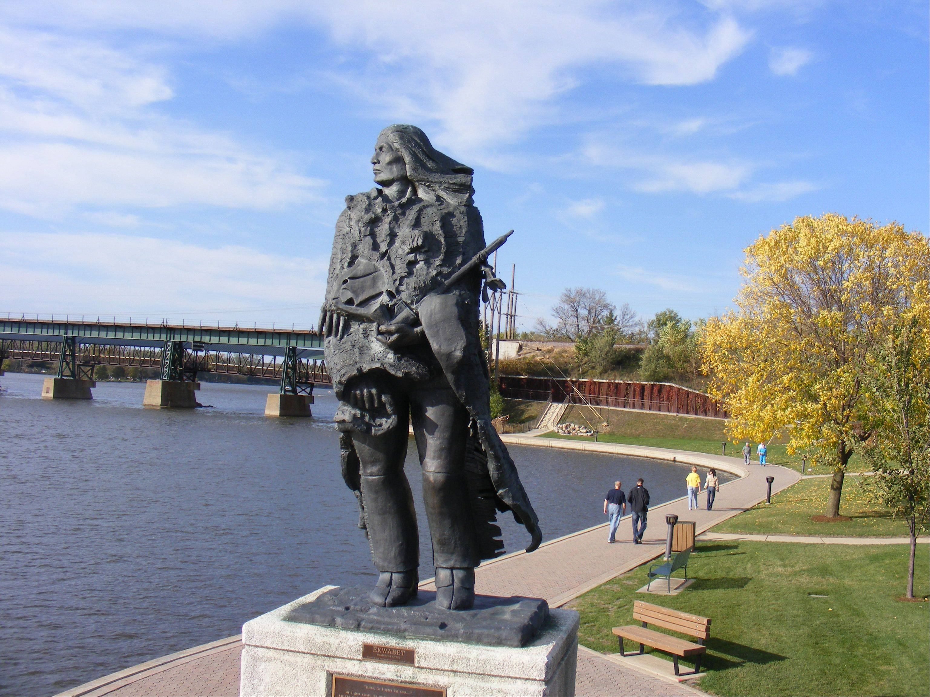 Ekwabet, by sculptor Guy Bellaver, overlooks the Fox River in downtown St. Charles.