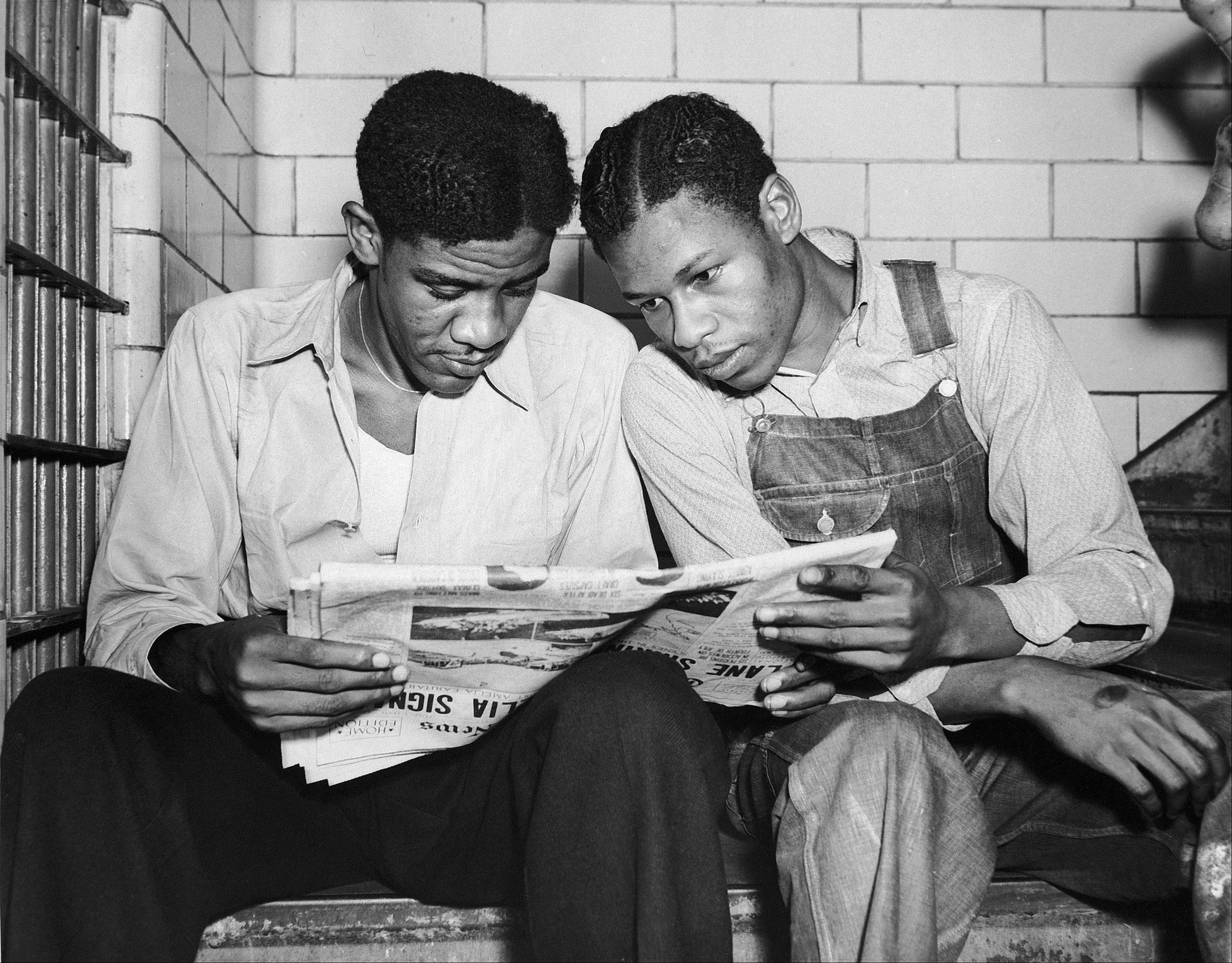 Associated Press/July 16, 1937Charlie Weems, left, and Clarence Norris, Scottsboro case defendants, read a newspaper in their Decatur, Ala. jail.