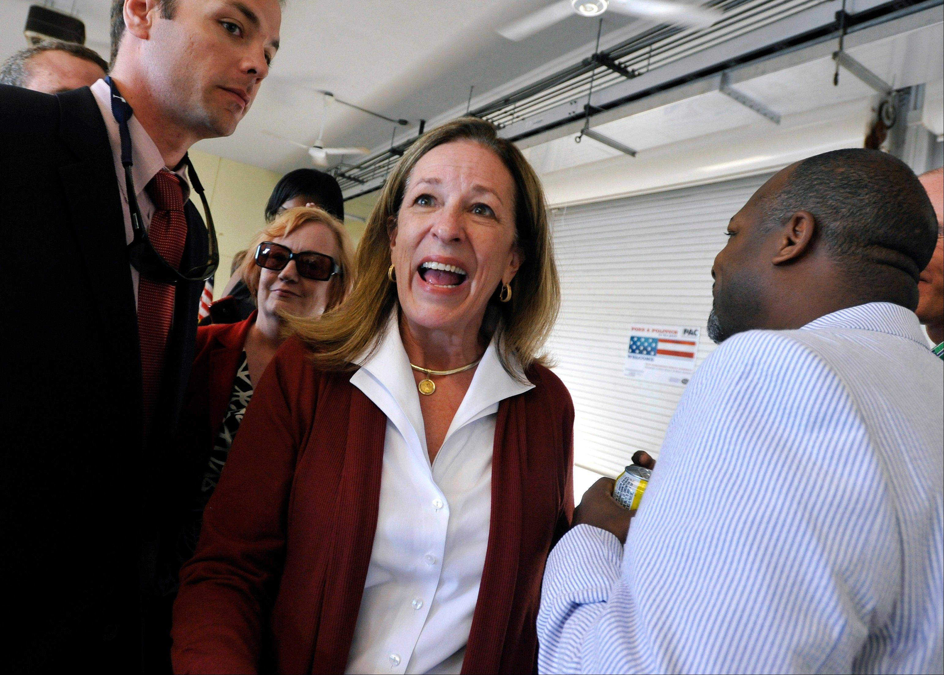 Associated PressDemocratic candidate Elizabeth Colbert Busch, center, speaks with attendees Tuesday during a campaign stop at the Charleston Maritime Center in Charleston, S.C.