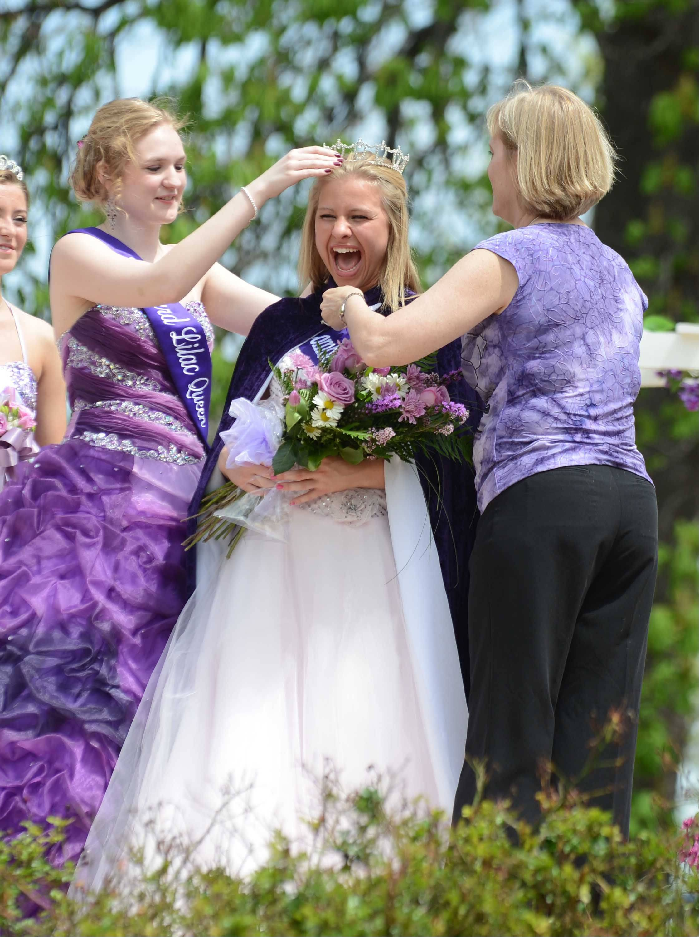 2012 Lilac Queen Jennie Mueller and Terri Soehrmann crown 2013 Lilac Queen Megan Cotterill on Saturday afternoon at Lilacia Park in Lombard. The coronation ceremony kicked off the 83rd annual Lilac Time, which runs until May 19 and will include tours, plant sales, concerts, an arts and crafts fair and parade.