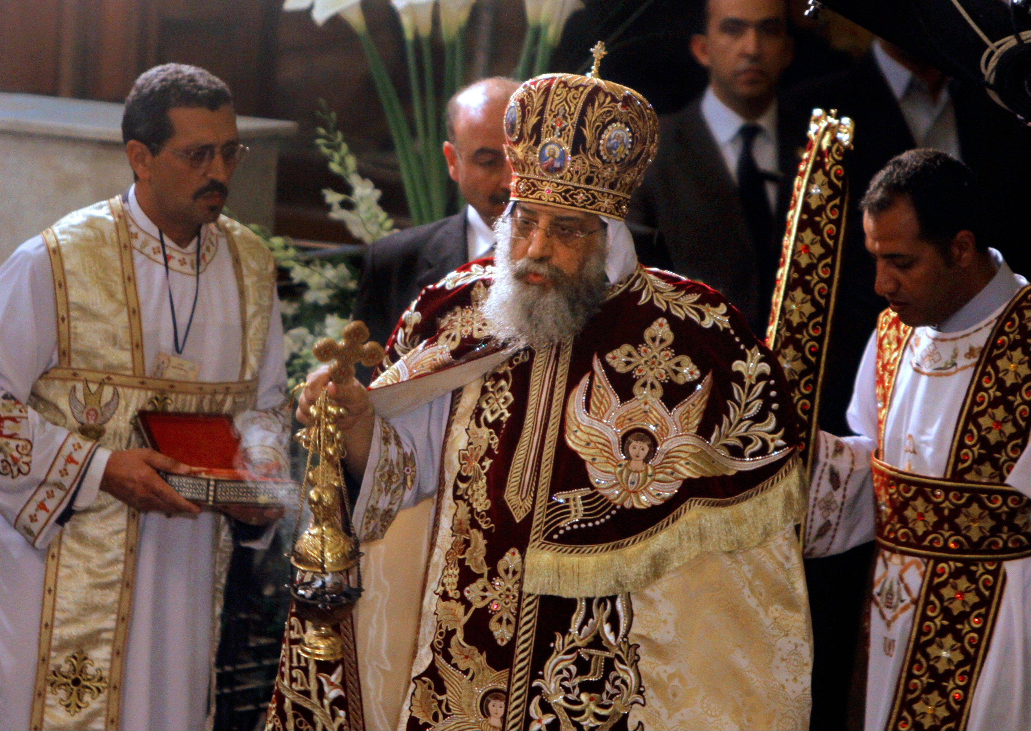 Pope Tawadros II, the 118th pope of the Coptic Church of Egypt, leads the Easter Mass Saturday at St. Mark's Cathedral in Cairo, Egypt.